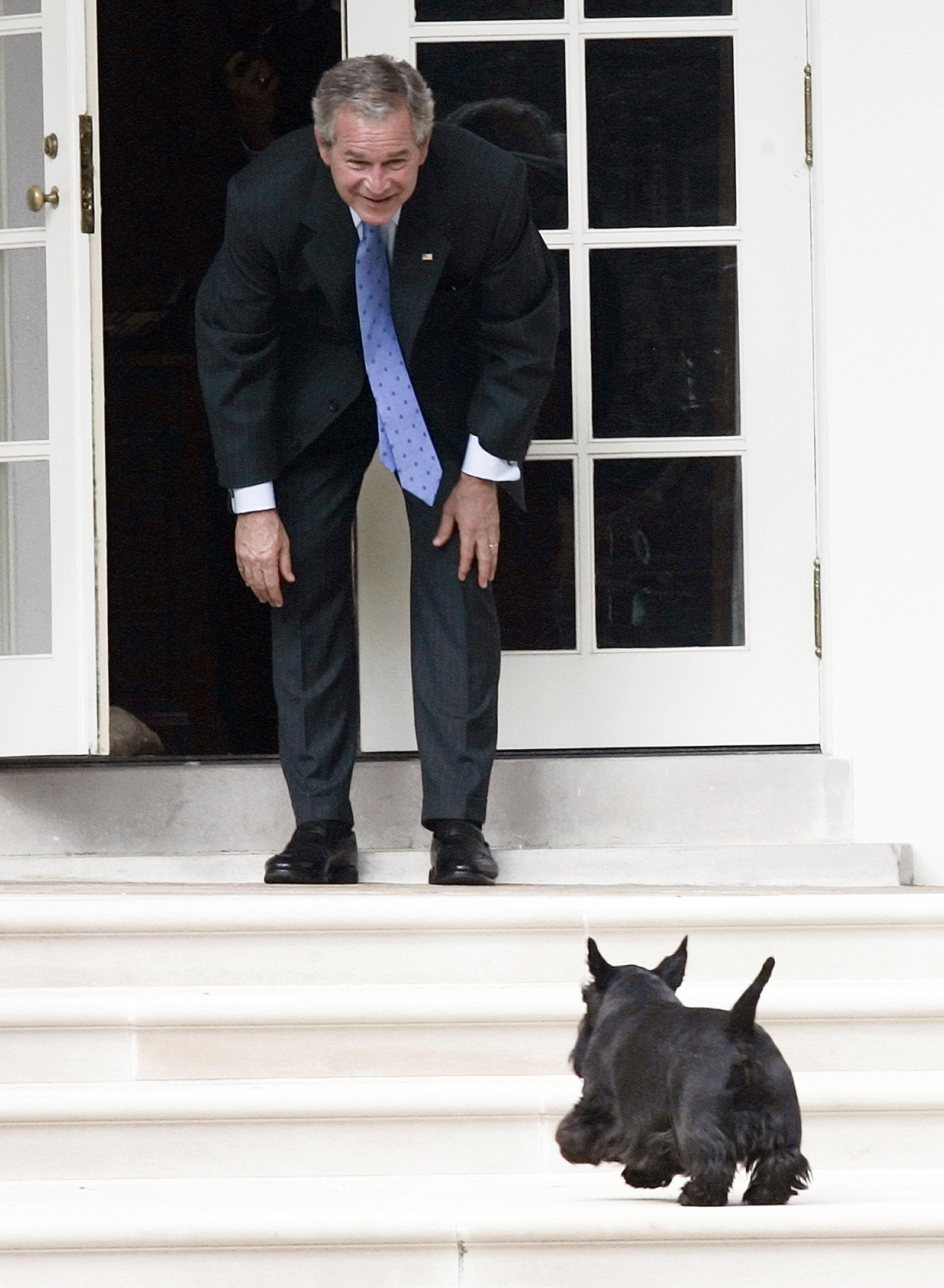 George W. Bush calls for his dog Barney as he stands on the West Wing Colonnade at the White House on Sept. 28, 2007.