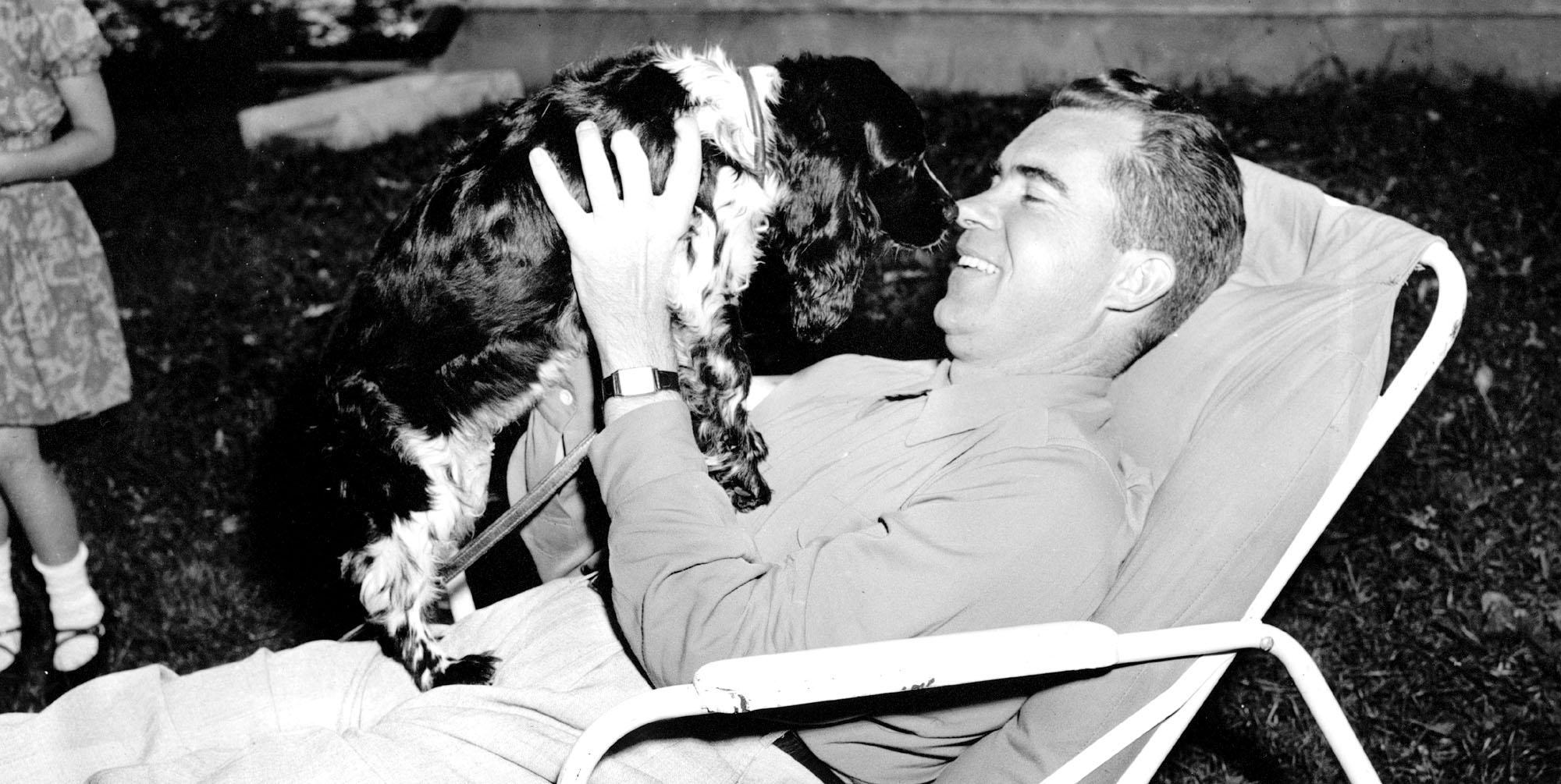 Richard M. Nixon plays with his family's black and white cocker spaniel  Checkers  at his home in Washington on Sept. 28, 1952.
