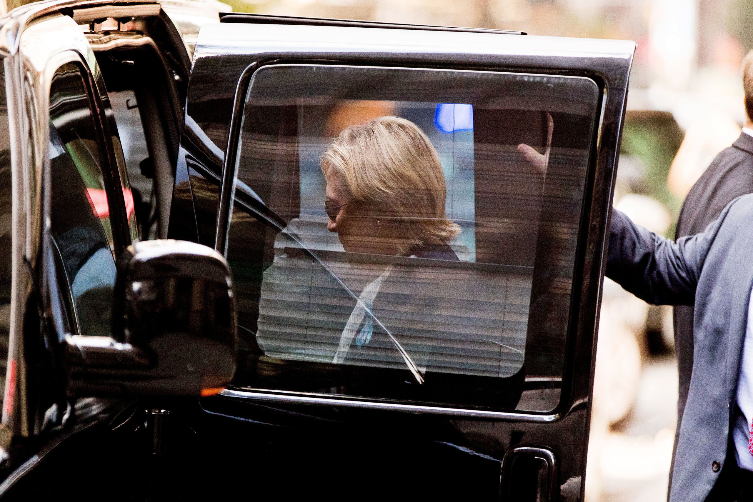 Clinton returns to her motorcade after briefly recuperating at her daughter Chelsea's apartment