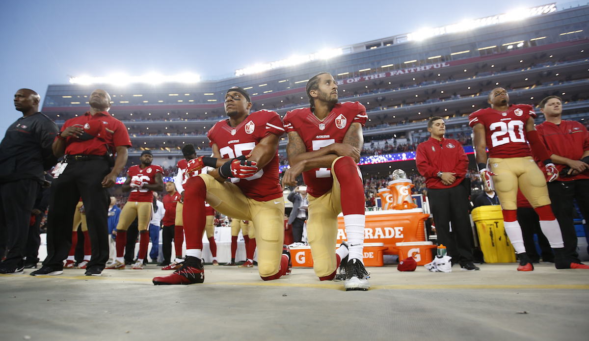 Eric Reid #35 and Colin Kaepernick #7 of the San Francisco 49ers kneel during the anthem, prior to the game against the Los Angeles Rams at Levi Stadium in Santa Clara, Calif, on Sept. 12, 2016.
