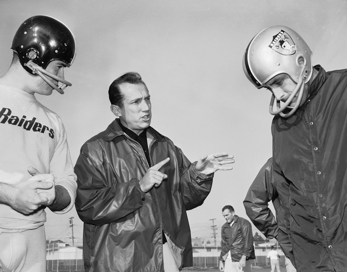 Al Davis, head coach of the American Football League's Oakland Raiders, is shown as he talked, Dec. 18, 1963 in Oakland with his players at the team's home practice field.