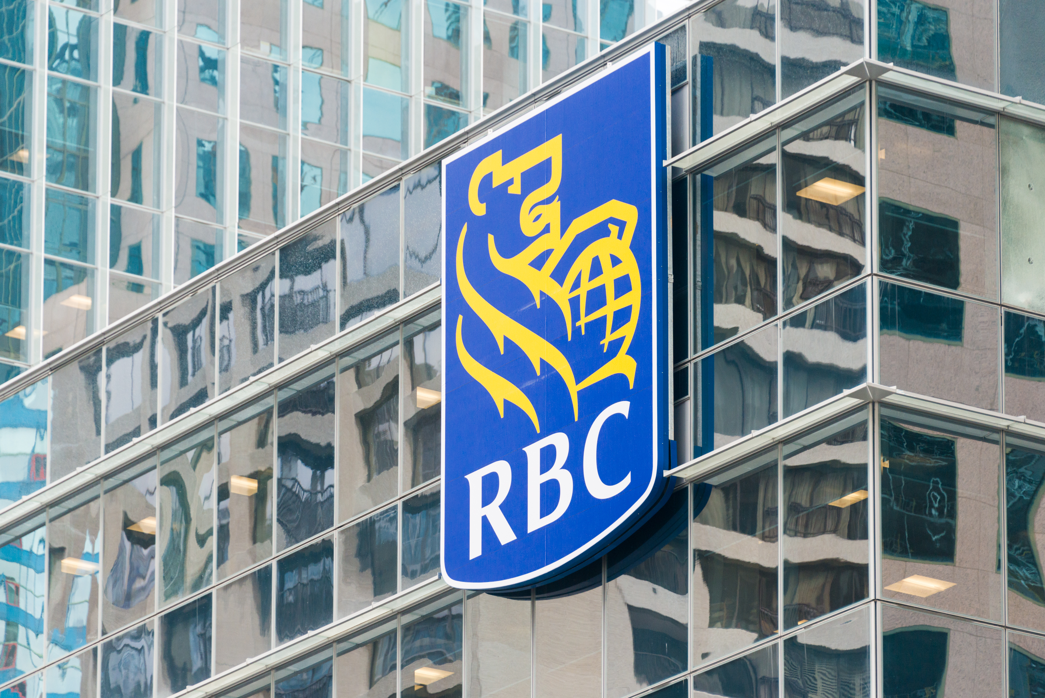 The symbol RBC on the glass facade of a building.