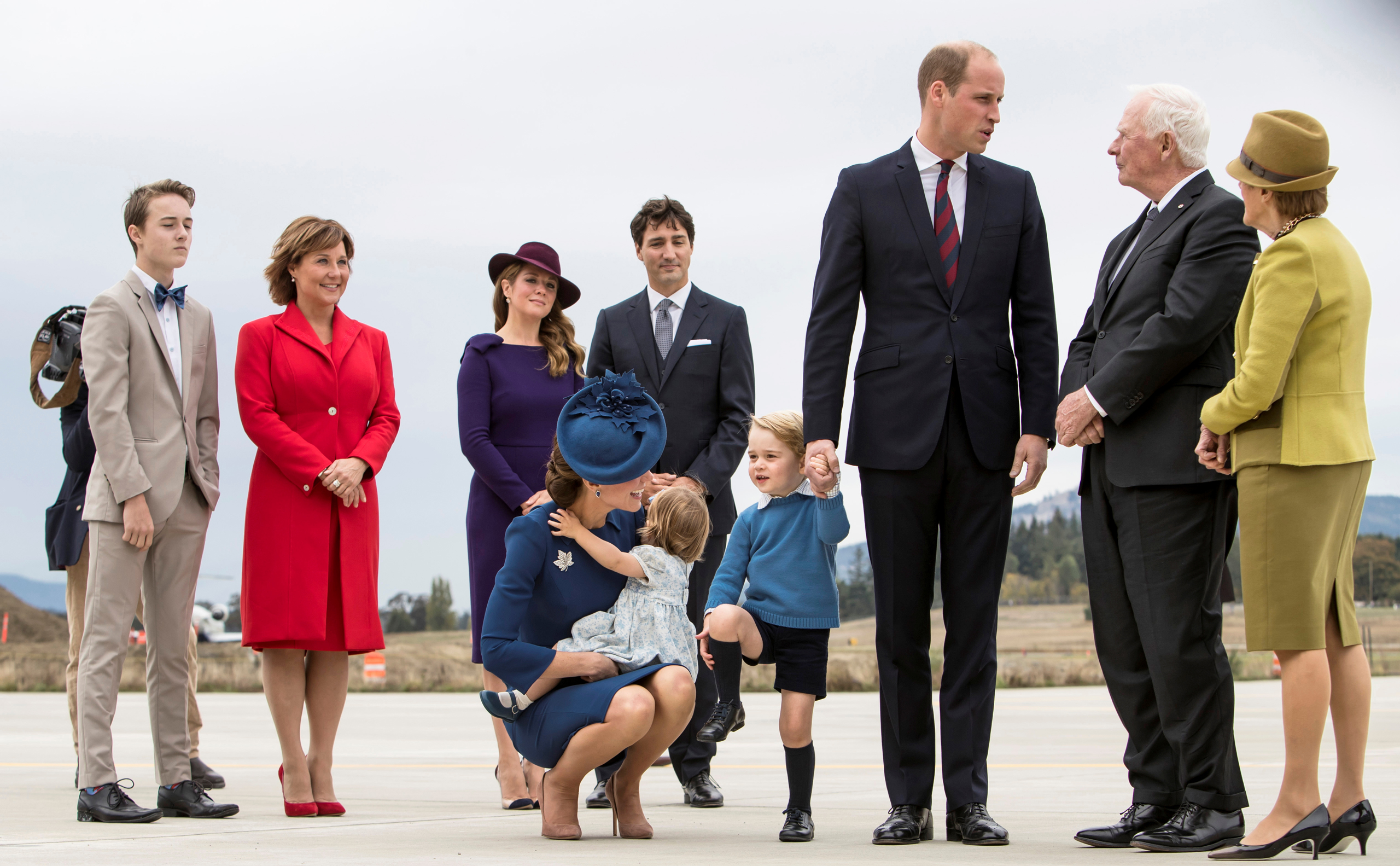 Britain's Prince William, Catherine, Duchess of Cambridge, Prince George and Princess Charlotte arrive at the Victoria International Airport for the start of their eight day royal tour to Canada in Victoria, British Columbia on September 24, 2016. Also pictured, in the rear, are Canada's Prime Minister Justin Trudeau and his wife Sophie Gregoire Trudeau.