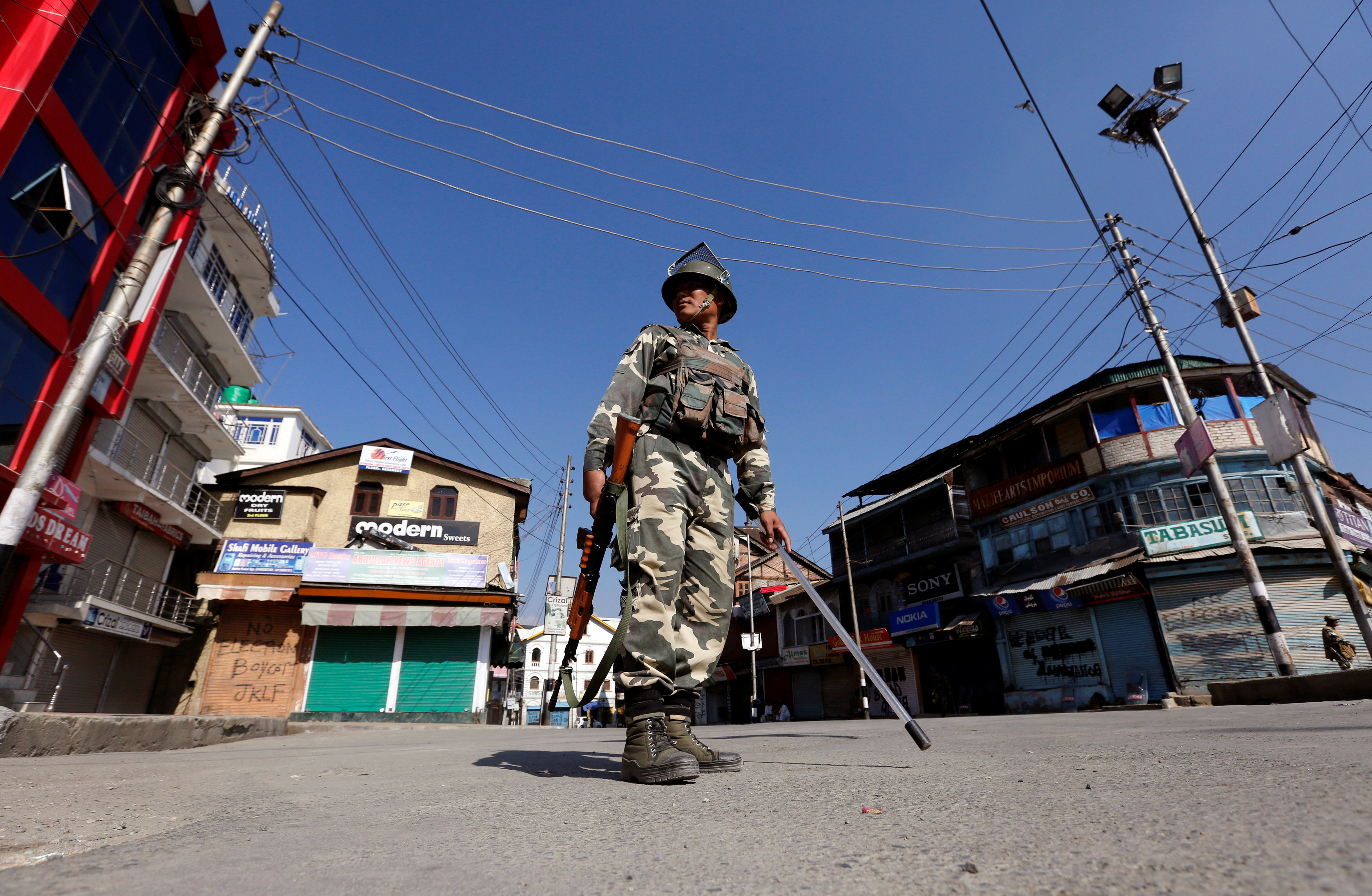 An Indian policeman stands guard in a deserted street during a curfew in Srinagar, in India-controlled Kashmir, on Sept. 19, 2016