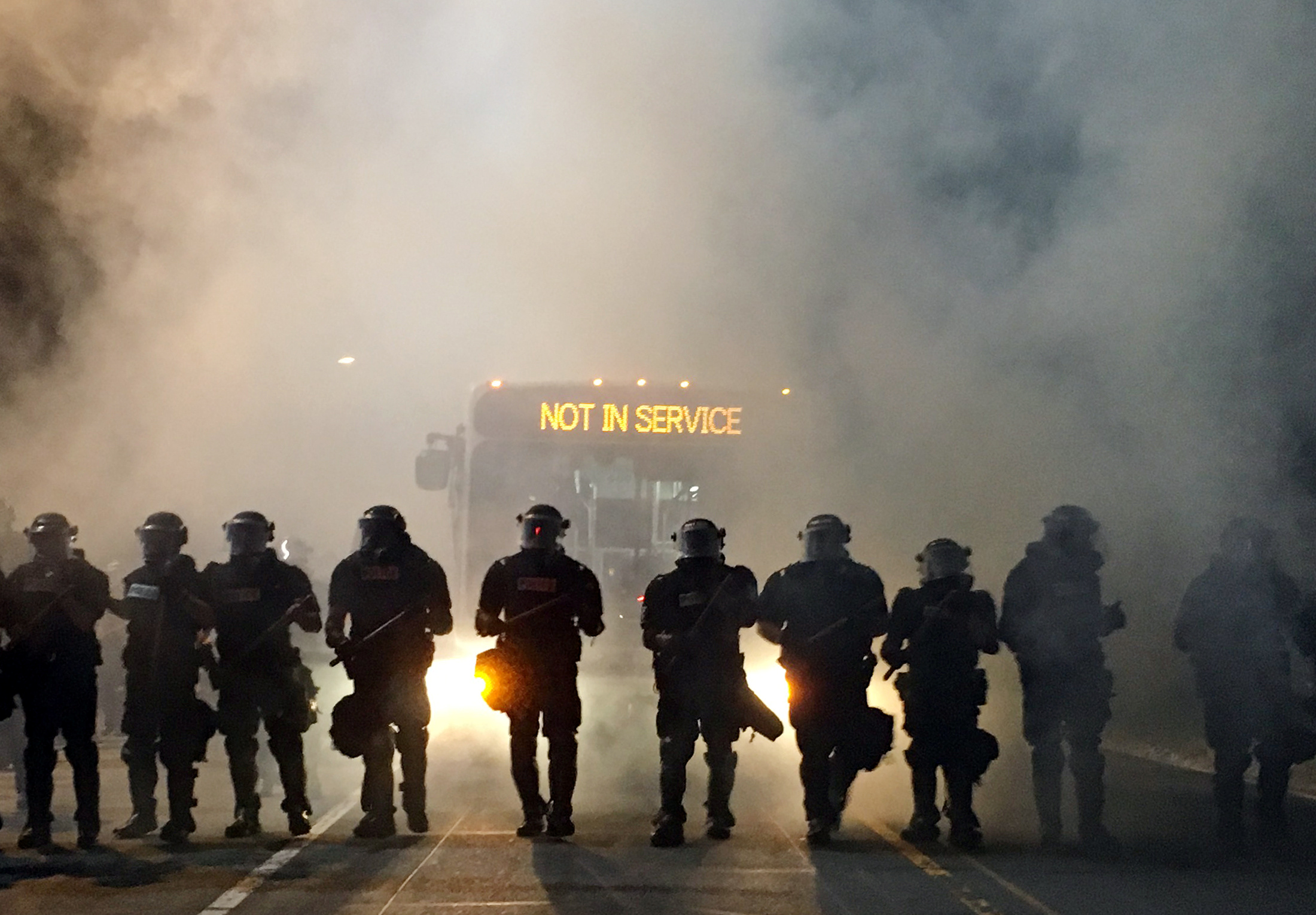 Police officers wearing riot gear block a road during protests after police fatally shot Keith Lamont Scott in Charlotte, North Carolina, Sept. 20, 2016.