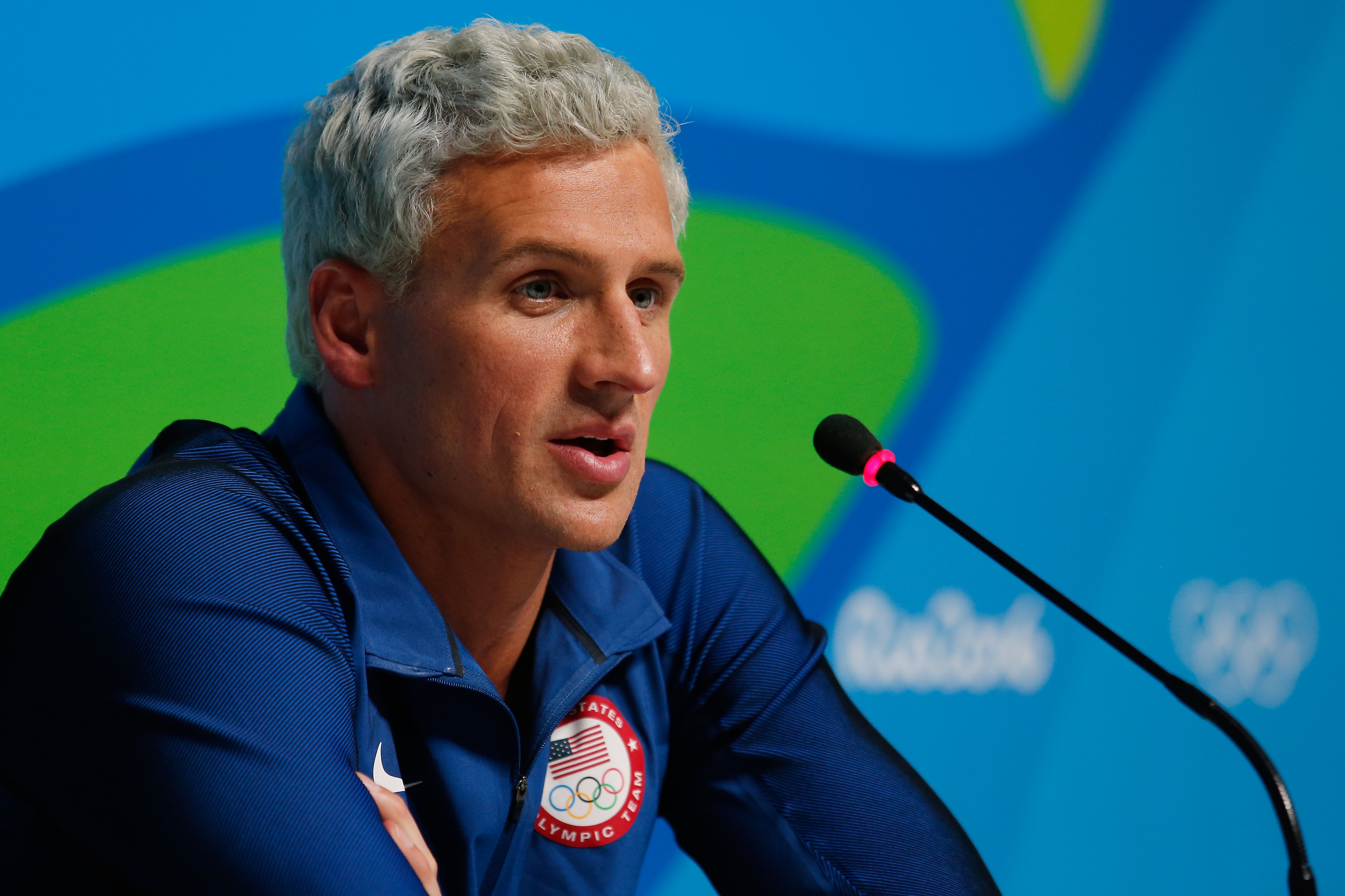 Ryan Lochte of the United States attends a press conference in the Main Press Center on Day 7 of the Rio Olympics on August 12, 2016 in Rio de Janeiro, Brazil.  (Photo by Matt Hazlett/Getty Images)