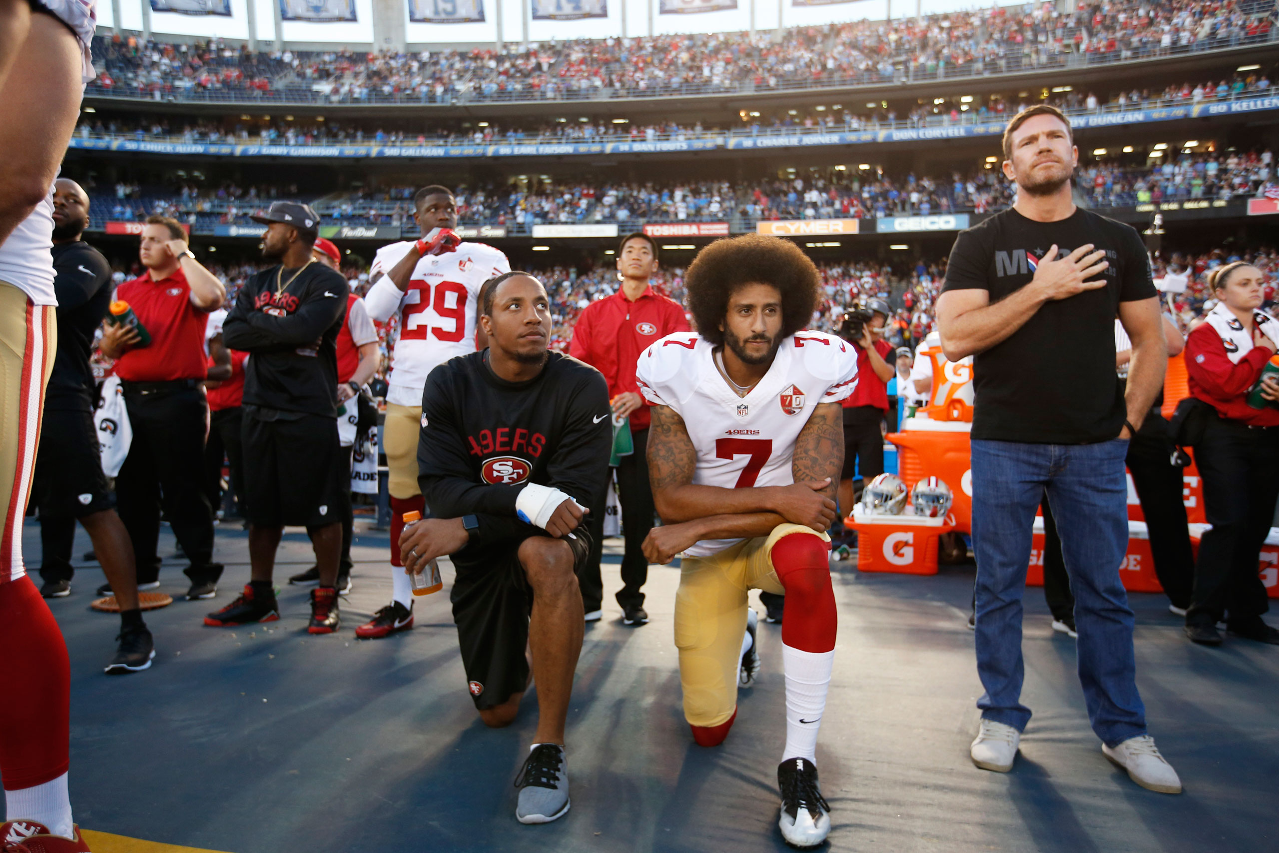 Eric Reid, left, and Colin Kaepernick of the San Francisco 49ers kneel during the national anthem on Sept. 1