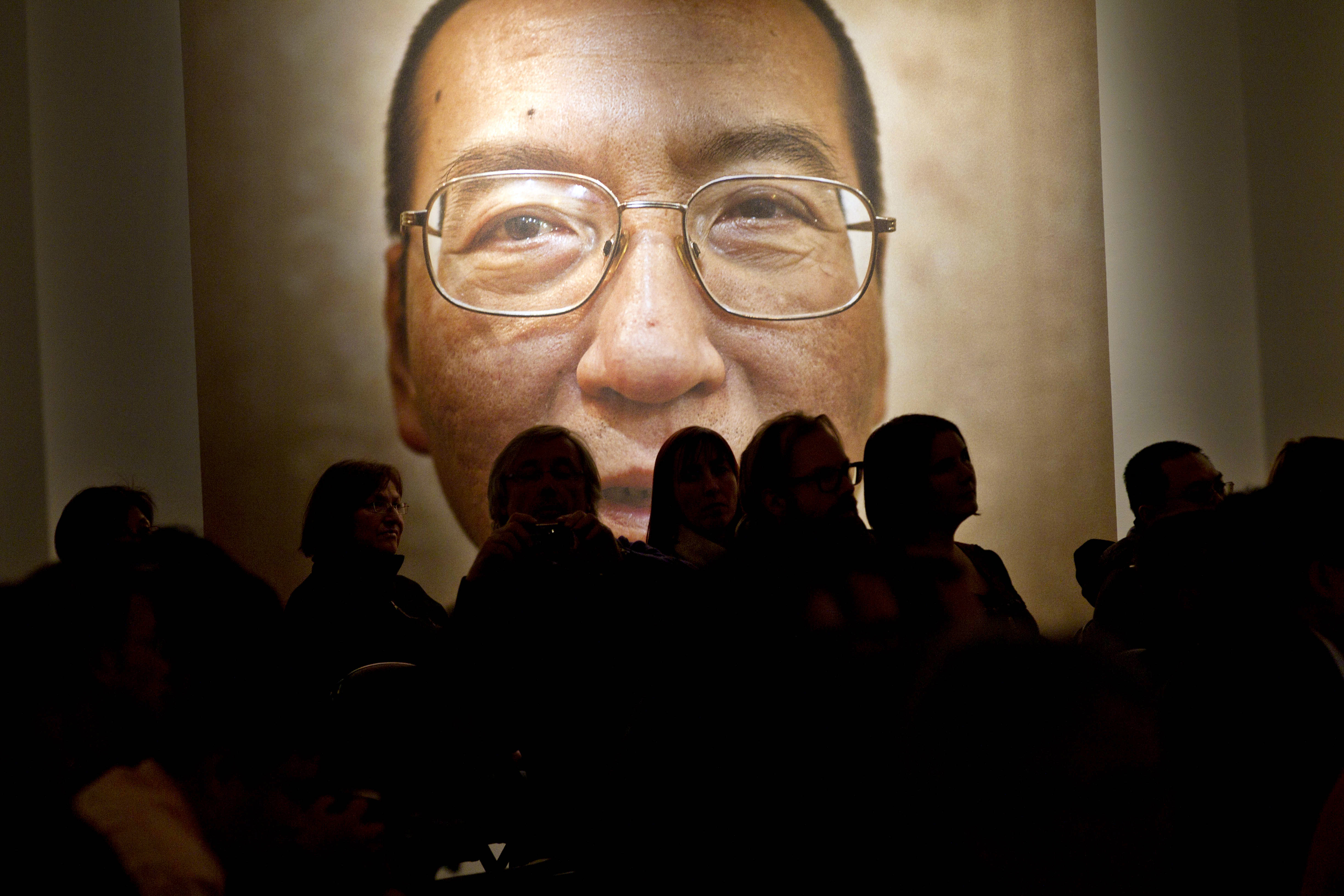 A picture of Liu Xiaobo seen inside the Nobel Peace Center on the day of The Nobel Peace Prize ceremony in Oslo on December 10, 2010. The head of the Nobel committee placed the year's peace prize on an empty chair as Beijing raged against the award to the dissident, who remains in a Chinese prison cell.