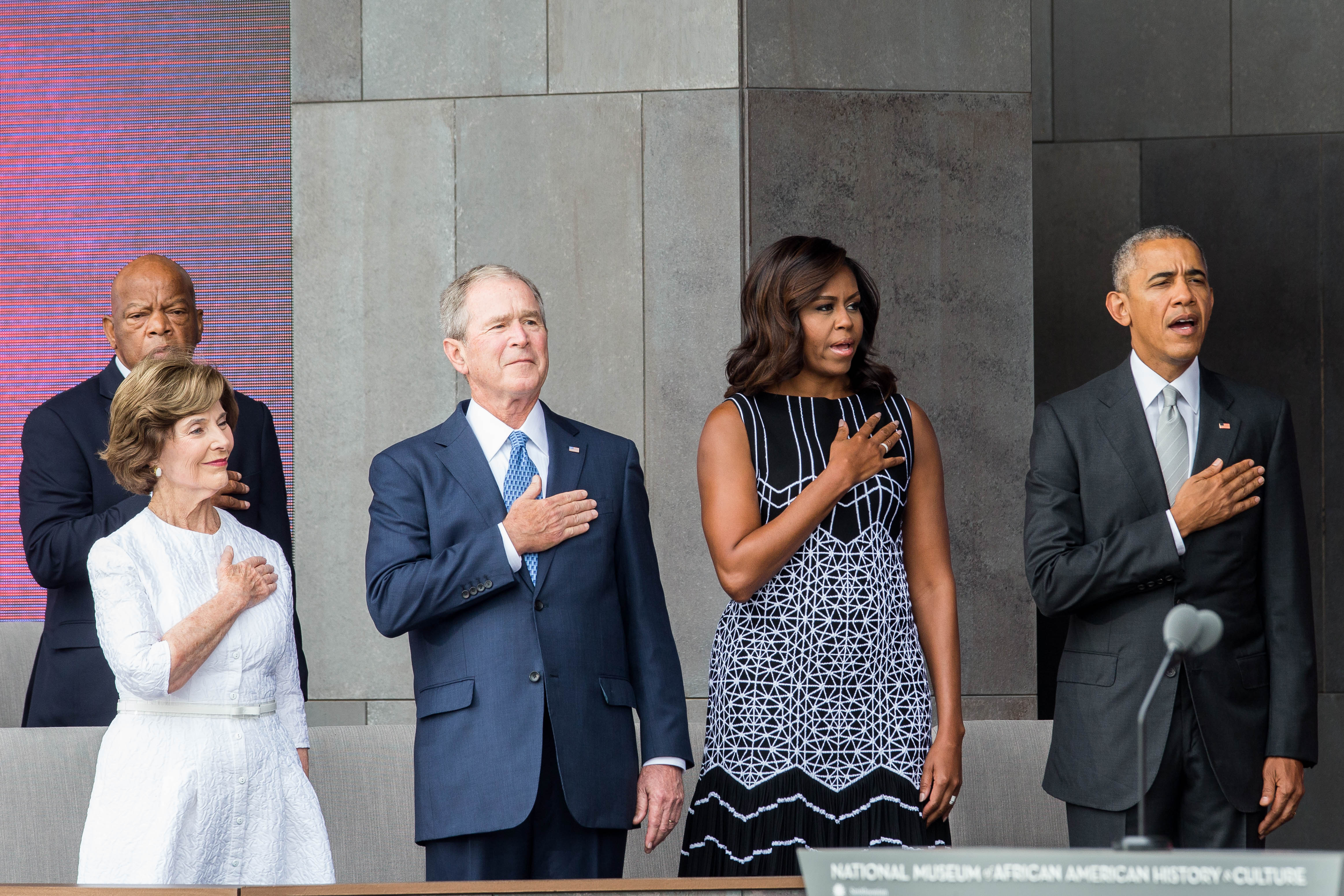Former First Lady Laura Bush, former President George W. Bush, First Lady Michelle Obama and President Barack Obama stand for the National Anthem during the opening ceremony for the Smithsonian National Museum of African American History and Culture on Sept. 24, 2016 in Washington, D.C.