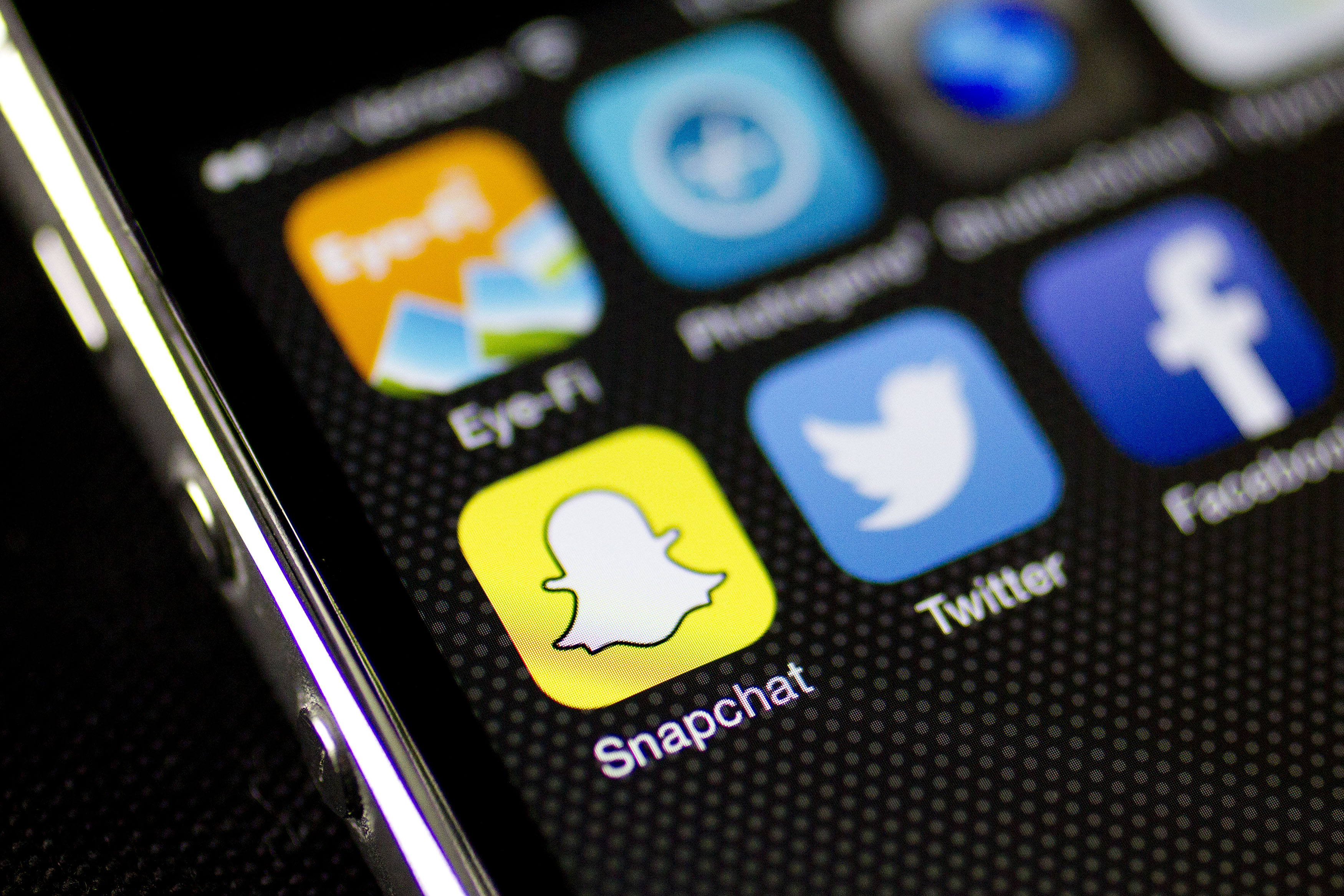 Snapchat is seen on an on an Apple Inc. iPhone 5s displayed for a photograph in Washington, D.C., on  Feb. 18, 2015.
