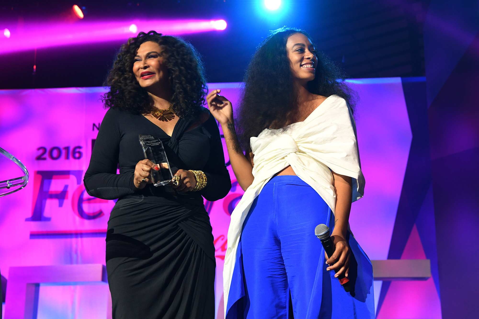 Tina Lawson Knowles and singer Solange Knowles speak on stage at the 2016 ESSENCE Festival in New Orleans, Louisiana.  (Photo by Paras Griffin/Getty Images for 2016 Essence Festival)
