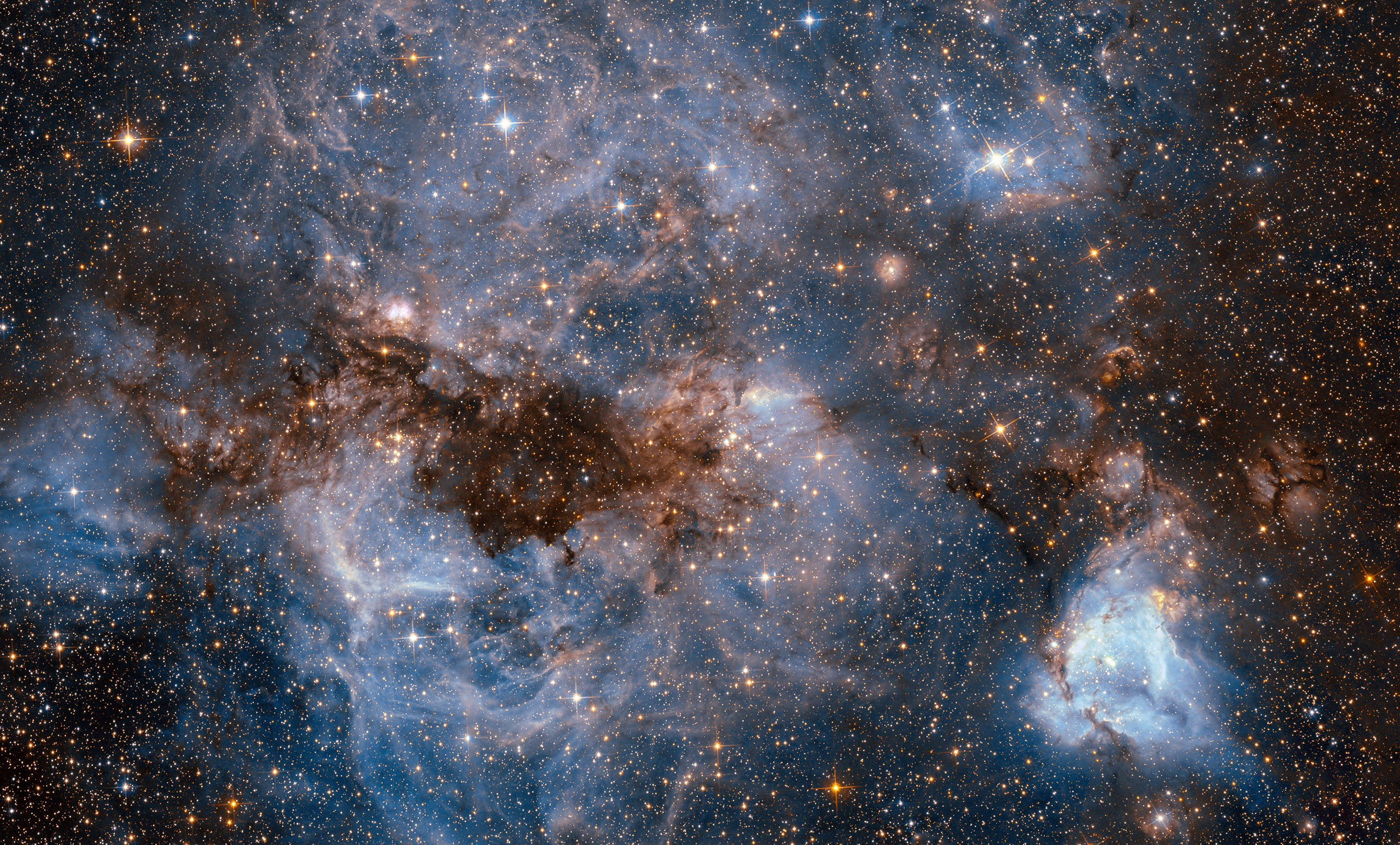 A maelstrom of glowing gas and dark dust within one of the Milky Way's satellite galaxies, the Large Magellanic Cloud, Sept. 5, 2016.