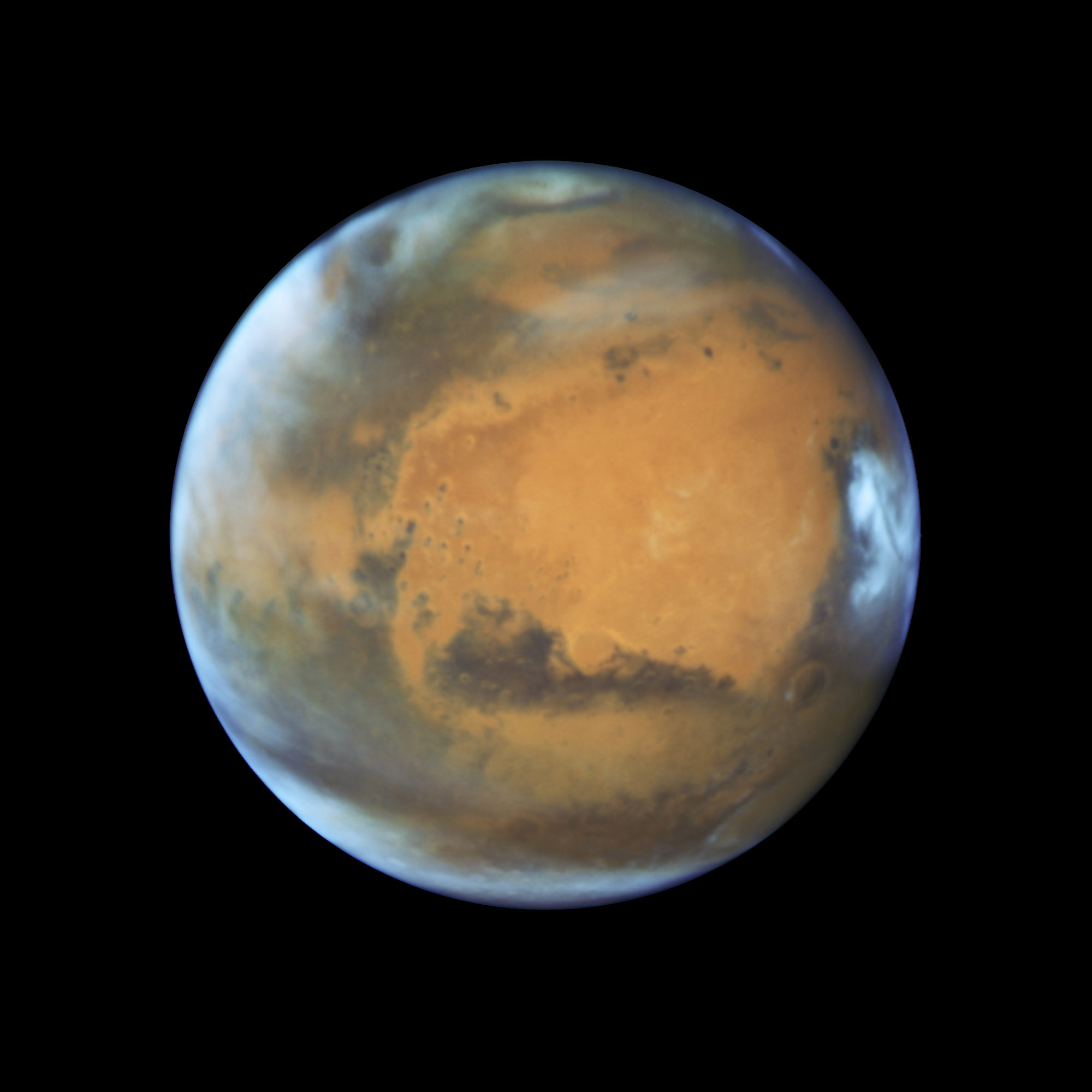 Bright, frosty polar caps, and clouds above a vivid, rust-colored landscape reveal Mars as a dynamic seasonal planet, May 12, 2016.