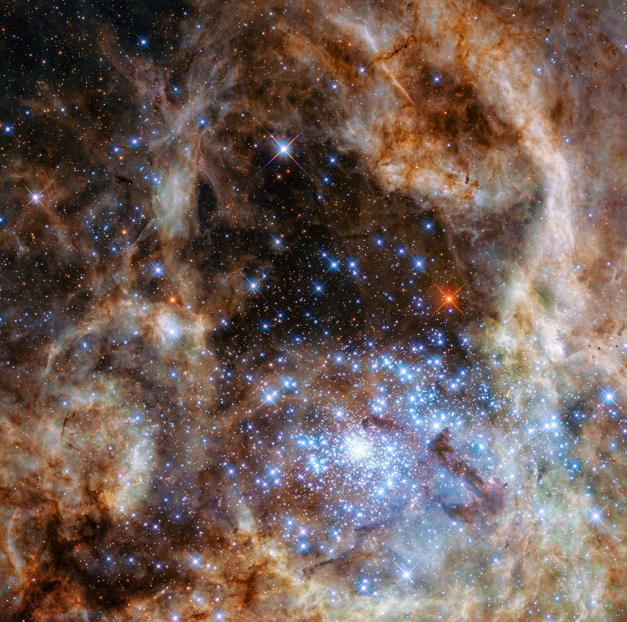 The central region of the Tarantula Nebula in the Large Magellanic Cloud, containing the R136 star cluster which contains hundreds of young blue stars, among them the most massive star detected in the universe so far, March 17, 2016.