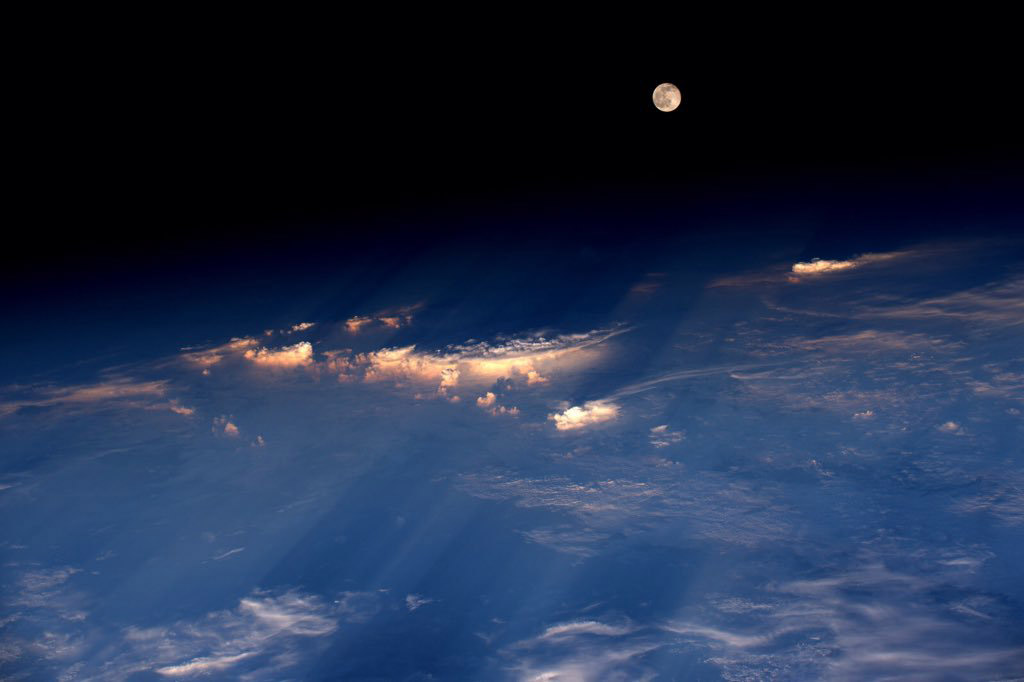 The full moon rises just before sunset, over western China, June 21, 2016.