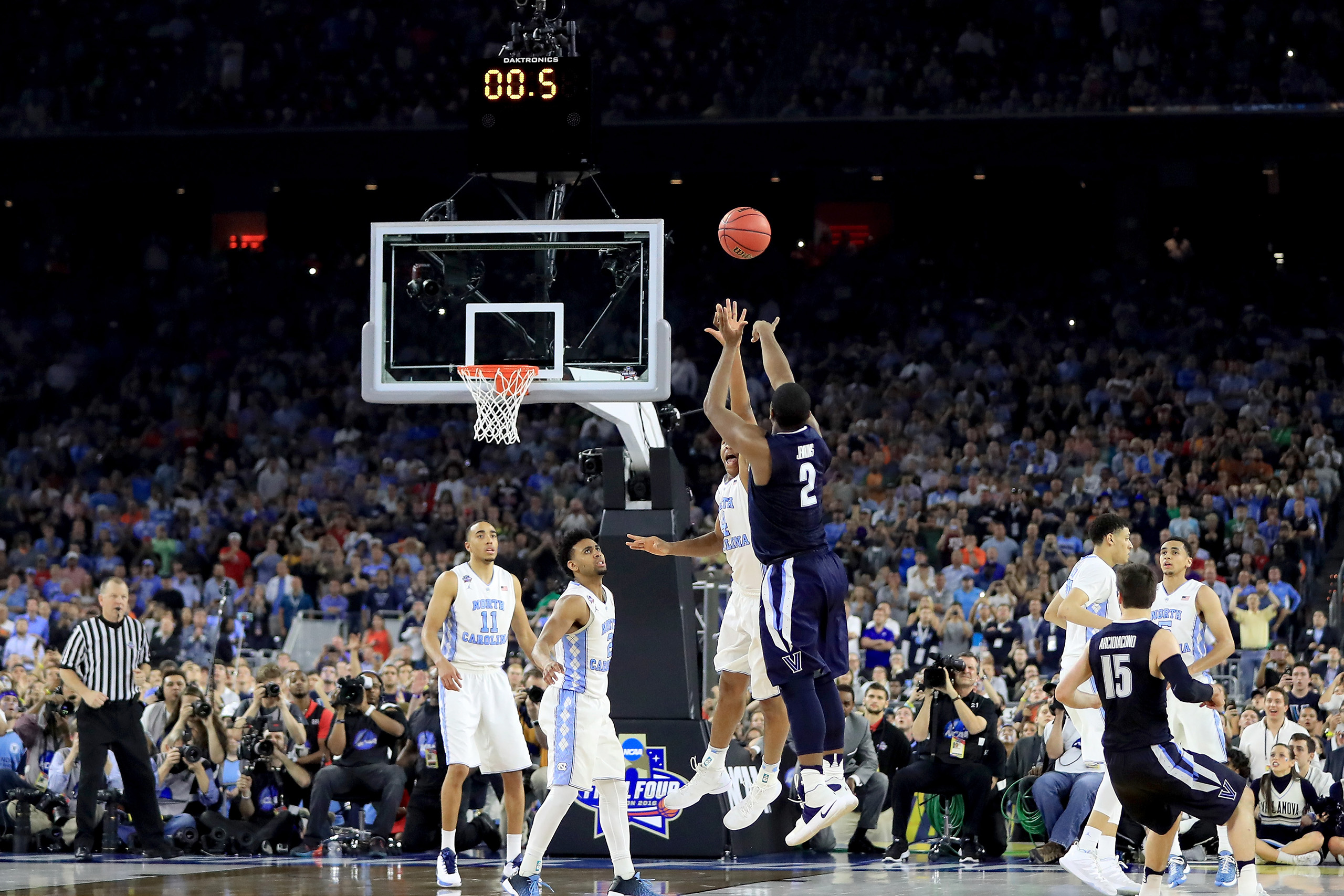 Kris Jenkins, #2 of the Villanova Wildcats, shoots the game-winning three pointer to defeat the North Carolina Tar Heels 77-74 in the 2016 NCAA Men's Final Four National Championship game at NRG Stadium in Houston, Texas, on April 4, 2016.