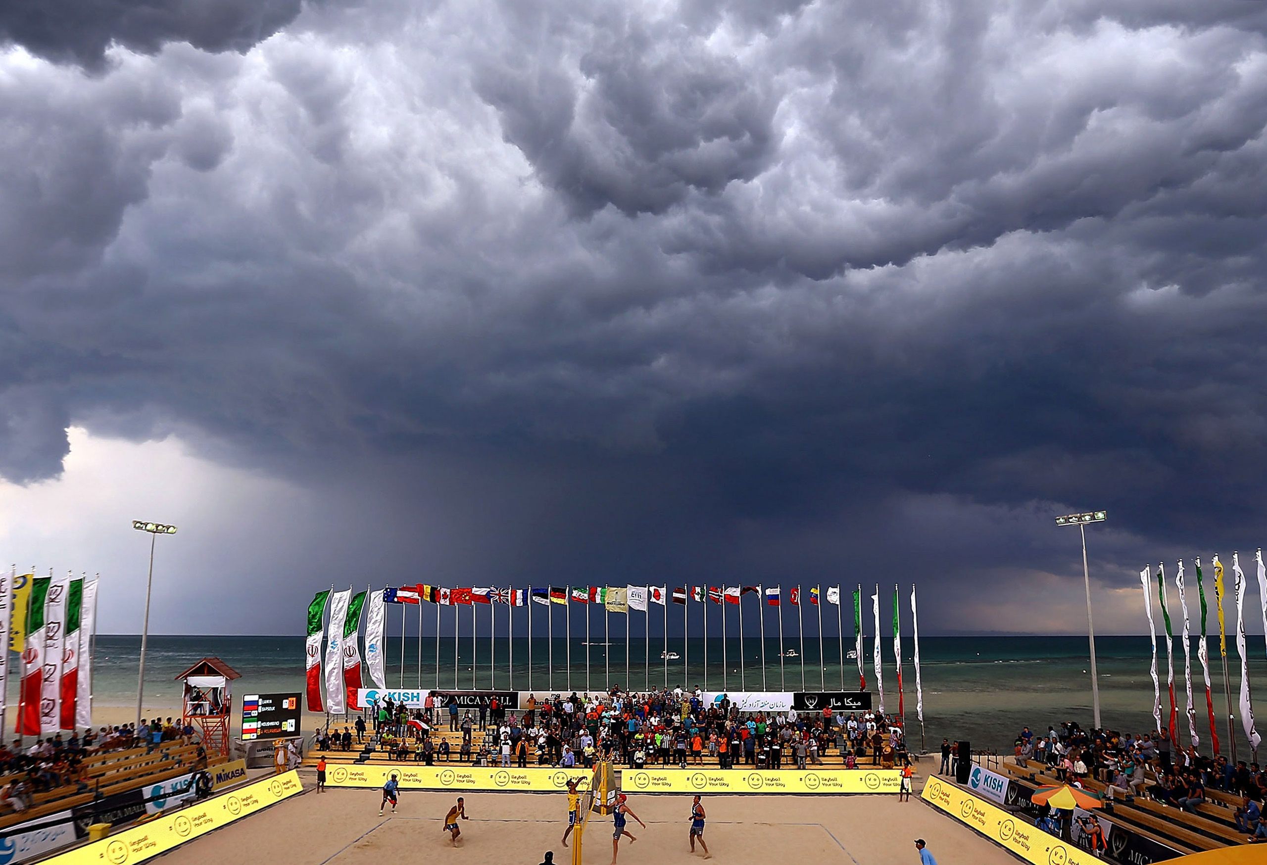 A general view of court action as the weather closes in on day 3 of the FIVB Kish Island in Iran on Feb. 17, 2016.