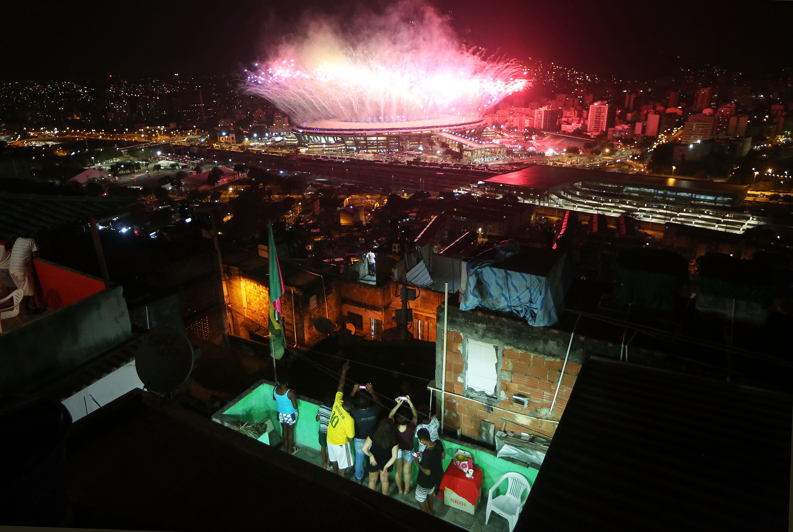 Fireworks explode over Maracana stadium with the Mangueira 'favela' community in the foreground during opening ceremonies for the Rio 2016 Olympic Games on Aug. 5, 2016.