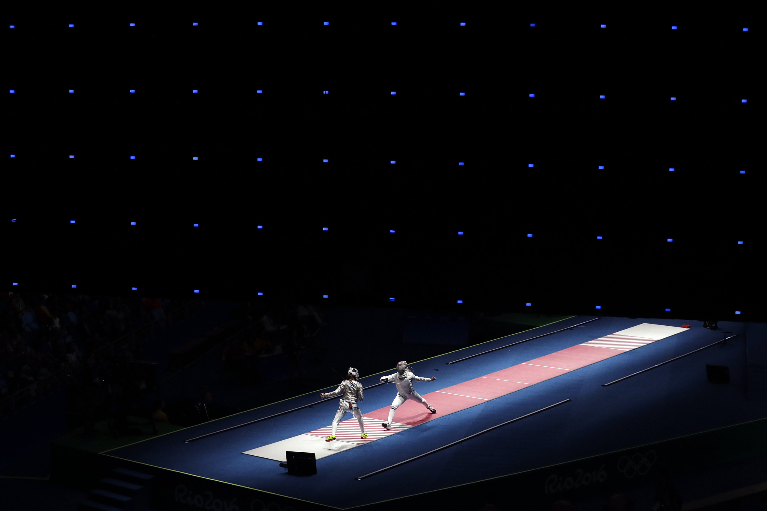 Anna Marton of Hungary, right, fences against Manon Brunet of France during women's saber individual fencing competition in the 2016 Summer Olympics in Rio de Janeiro, Brazil, Aug. 8, 2016.