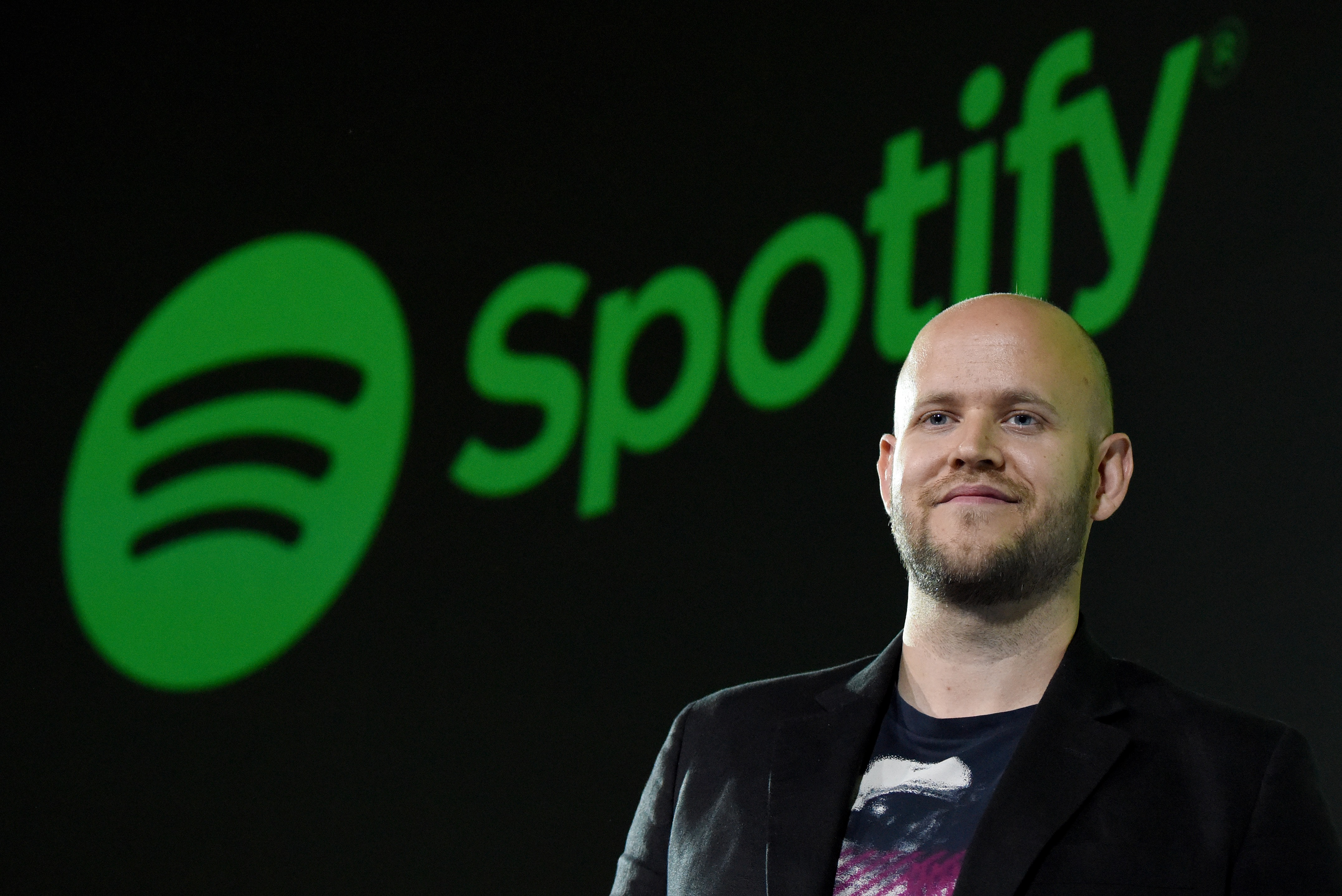 Daniel Ek, CEO of Swedish music streaming service Spotify, poses for photographers at a press conference in Tokyo on September 29, 2016.