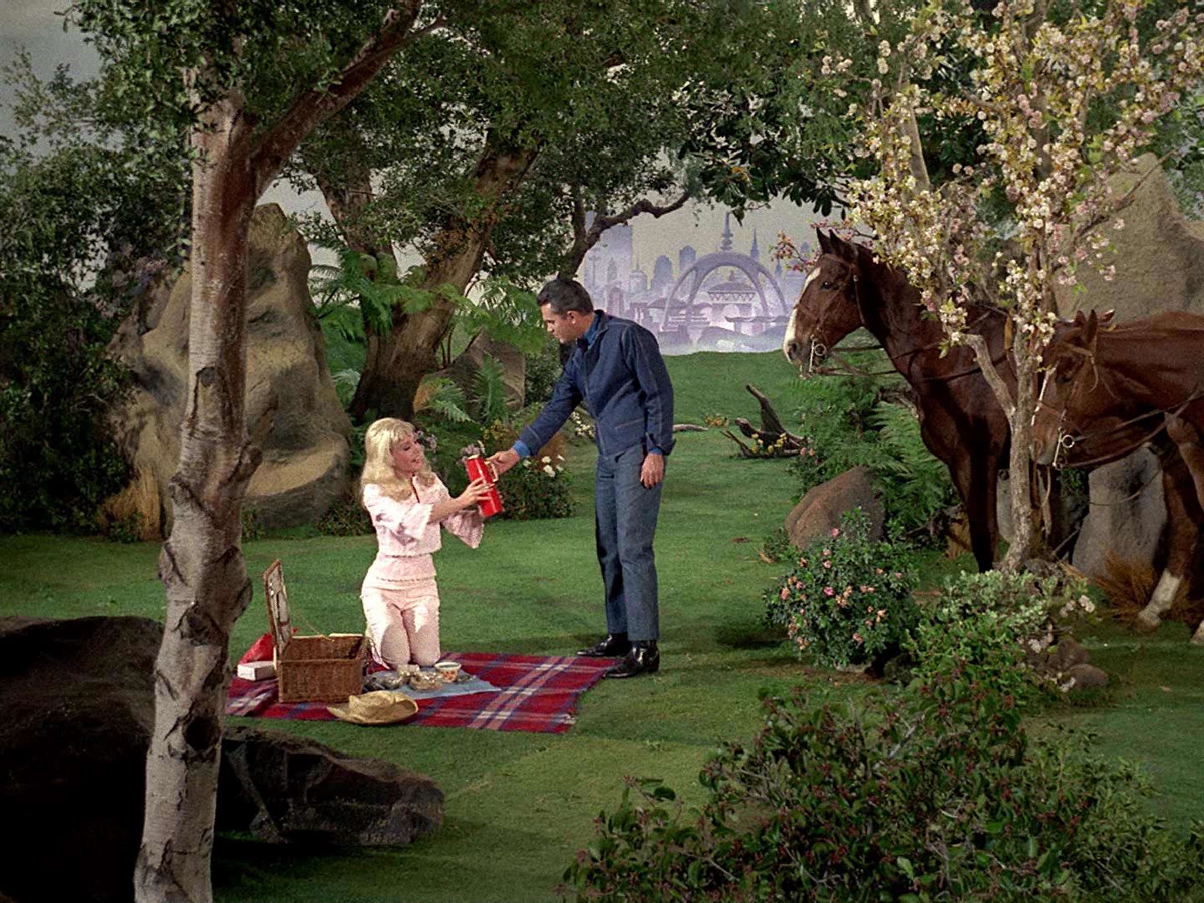 Susan Oliver as Vina and Jeffrey Hunter as Captain Christopher Pike have an illusory picnic outside Mojave, Kirk's home.