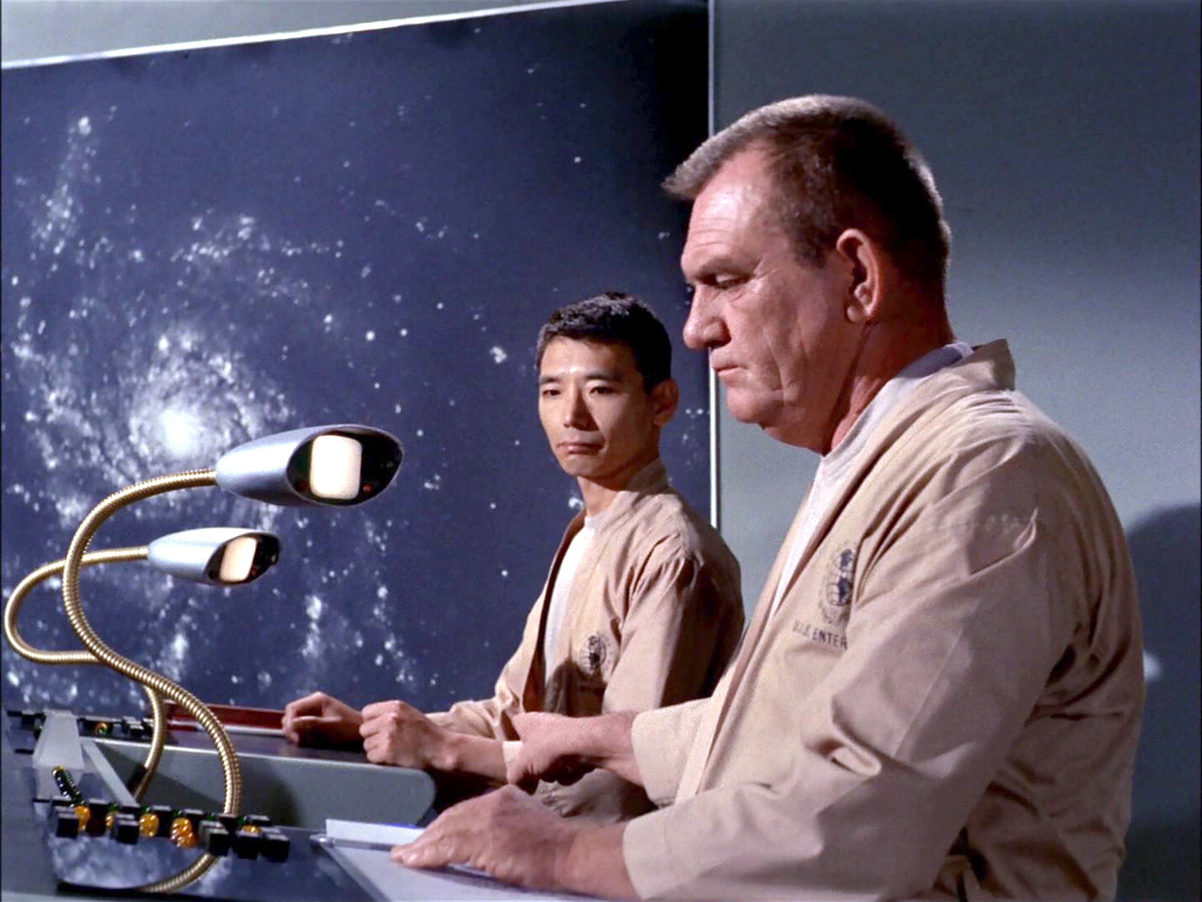 Crew members in the transport room of the USS Enterprise.