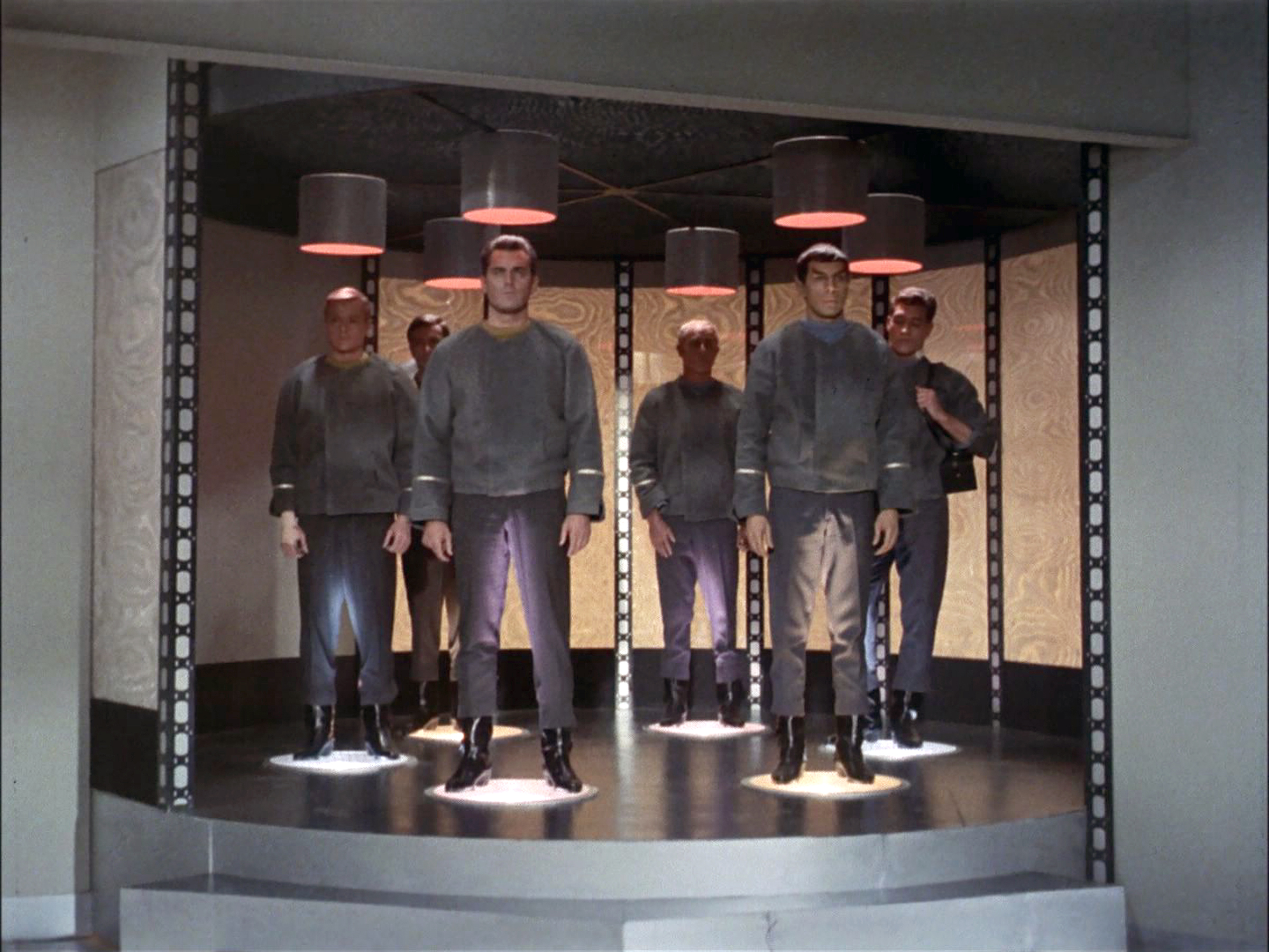 The crew of the USS Enterprise being transported. From left: Peter Duryea as Lieutenant José Tyler, Adam Roarke as Communications Officer Garison, Jeffrey Hunter as Captain Christopher Pike, John Hoyt as Dr. Phillip Boyce, Leonard Nimoy as Mr. Spock and Ed Madden as the Enterprise Geologist.