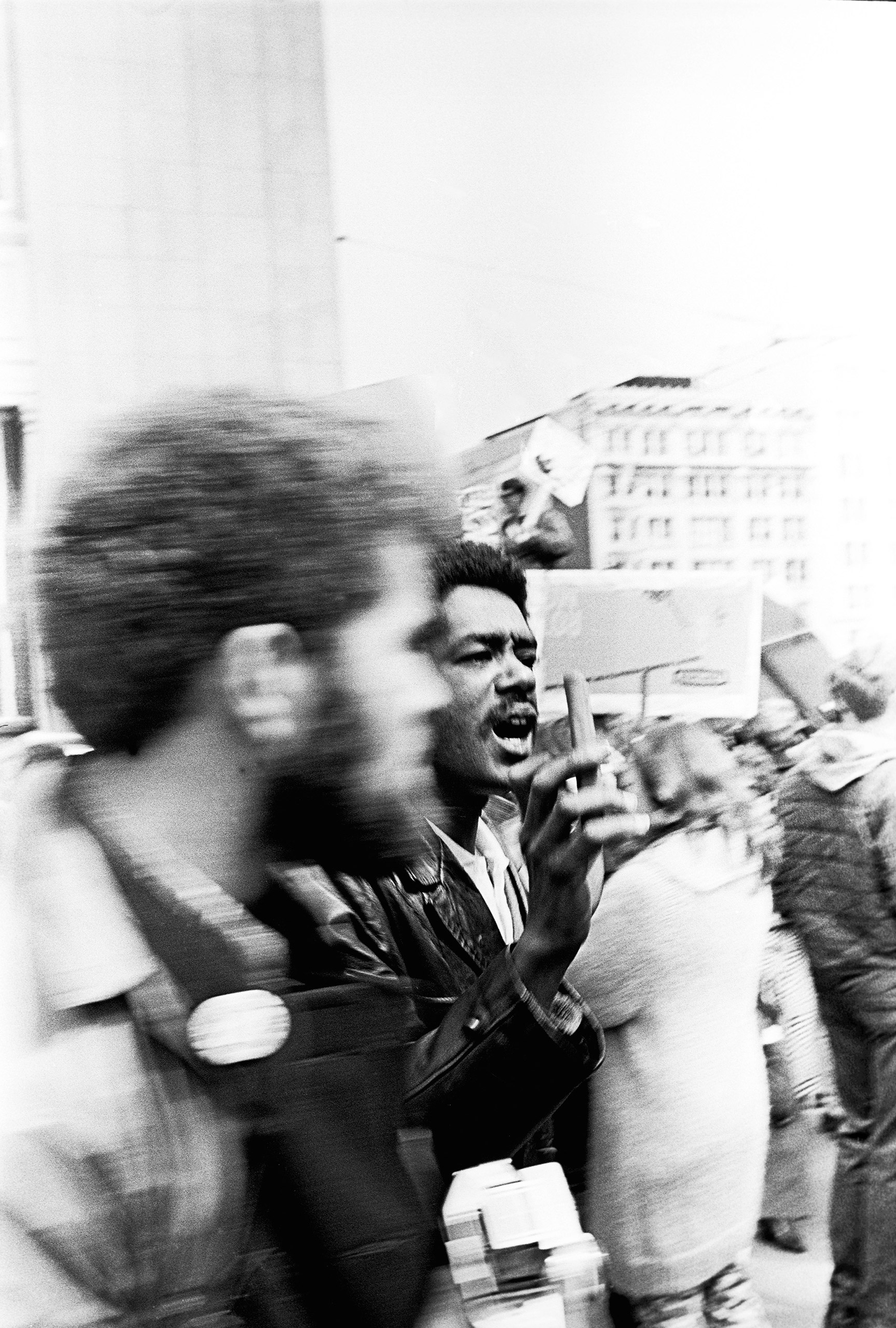 Bobby Seale sells Mao's  Red Book  to raise money at the first San Francisco Peace March against the Vietnam War, Kezar Stadium, April 15, 1967.