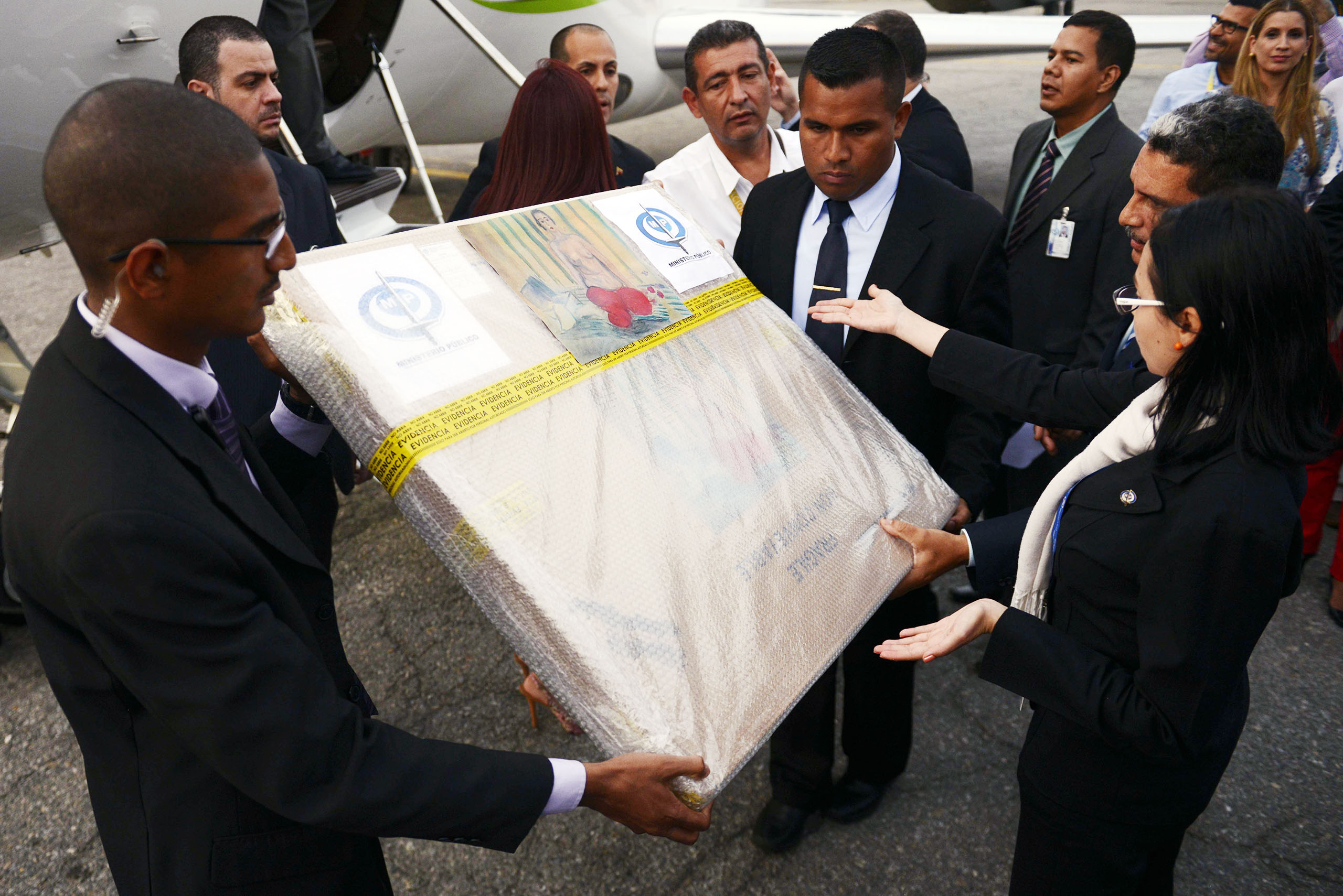 Venezuelan authorities hold the package containing Henri Matisse's painting  Odalisque in Red Pants  upon its arrival in Caracas from the US, on July 7, 2014.