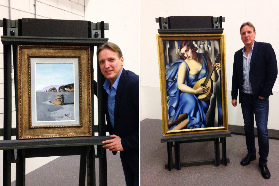 Art investigator Arthur Brand stands with two paintings he recovered,  Adolescence  by Salvador Dali and  La Musicienne  by Tamara de Lempicka, July 26, 2016.