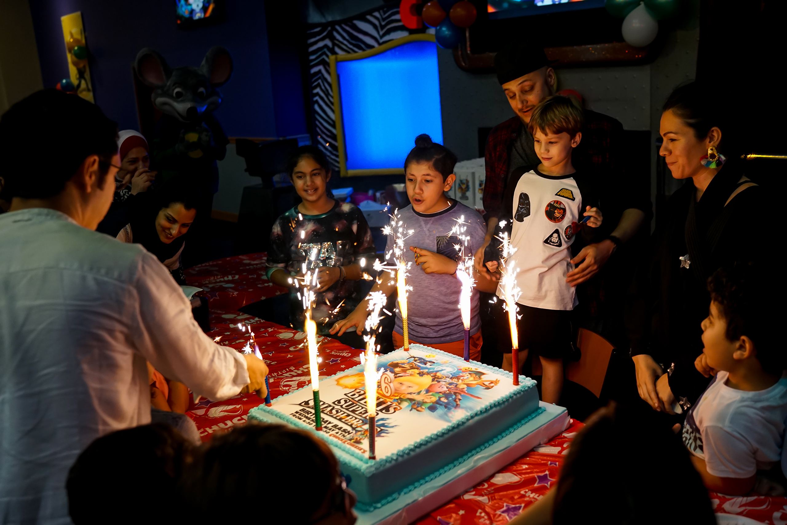 Nasiba, along with family and friends and the boy's father, her ex-husband, celebrate his 5th birthday at a Chuck E. Cheese's in Jeddah, May 2016.