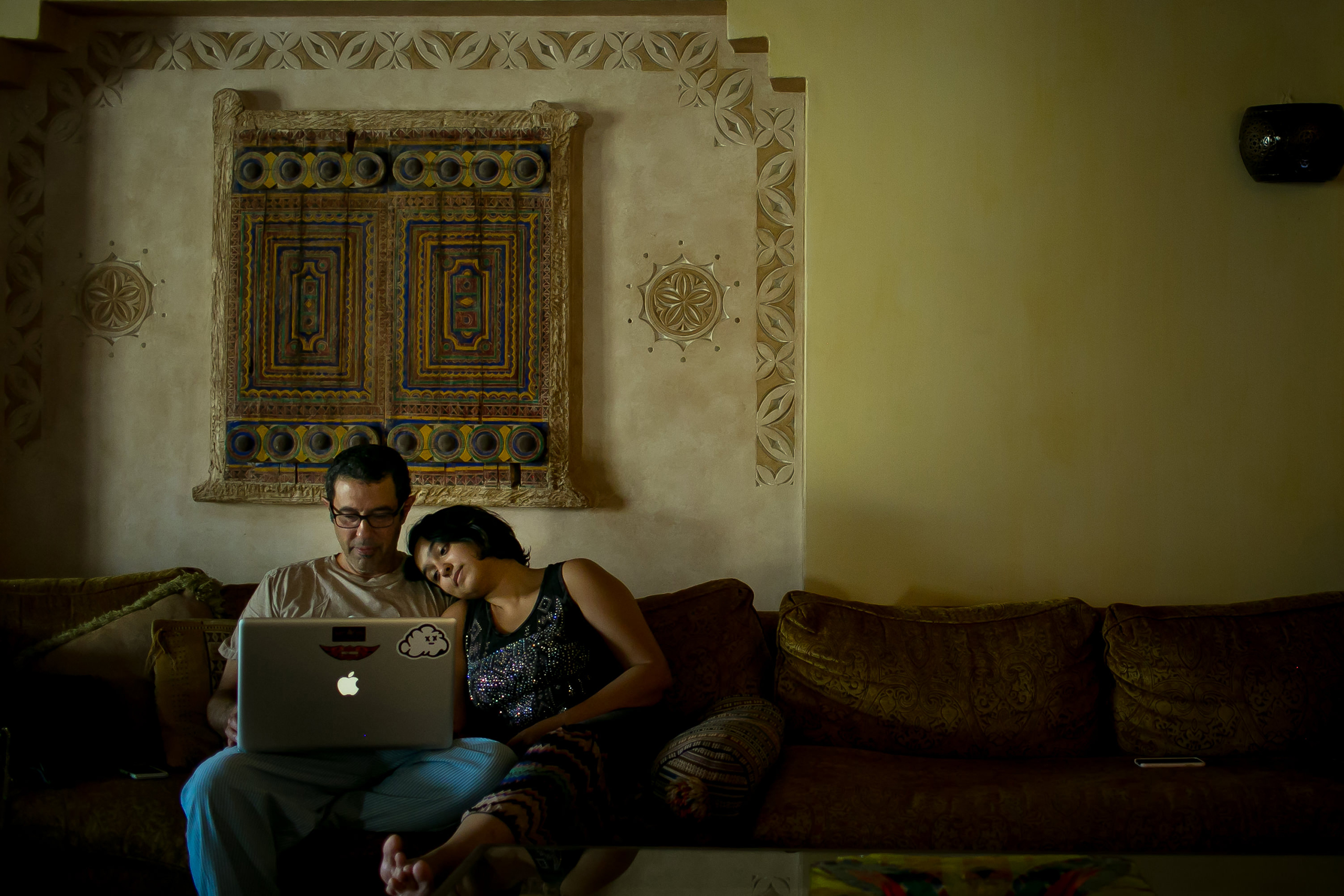 Raneen, an art curator and gallery owner, sits with her father while Facetiming her husband on the computer at her parents' home in Khobar, October 2015.  My father sat beside me filming as I drove, joining fellow women drivers pushing back in well documented 2013 protests,  she told the photographer.  It is with my parents support that I was able to find love, to follow my dream of opening a gallery and be the woman I am.