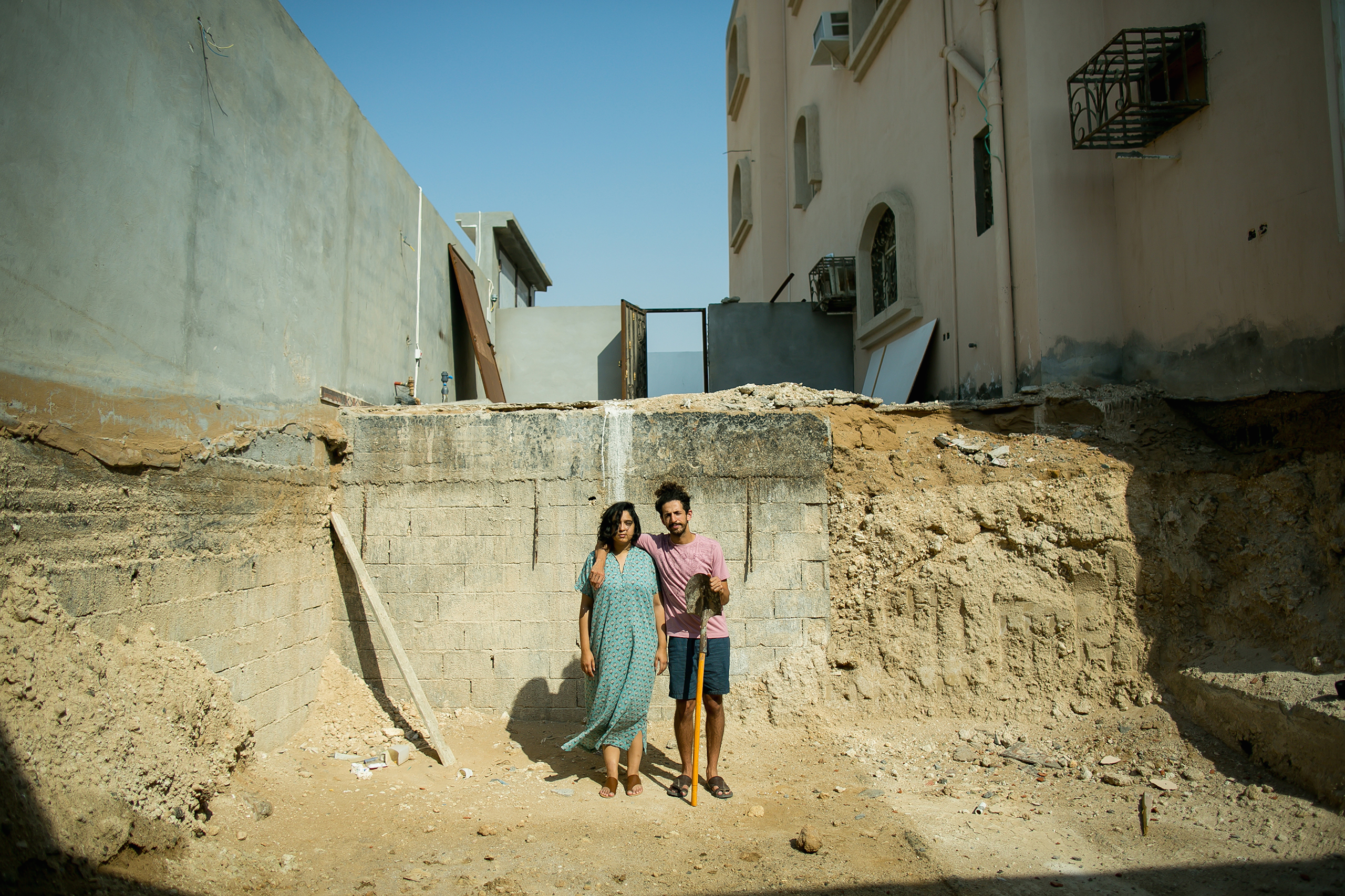 Raneen, an art curator and gallery owner, and Hisham, a comedian and actor, opted for a Saudi-style  American Gothic  portrait in their unfinished swimming pool in Jeddah, December 2015.  I first met her on Twitter, then later in person,  Hisham said.  Wanting nothing but fun, she told me off... I met her again at an ice cream shop. She charmed me with her happy ice cream dance.  Raneen and Hisham were both previously married and divorced. Now married to each other, they realize their past mistakes.  We didn't believe in love, and were too cynical. We also thought of marriage as a duty. After we stopped searching for the one, that's when we met each other,  he said.