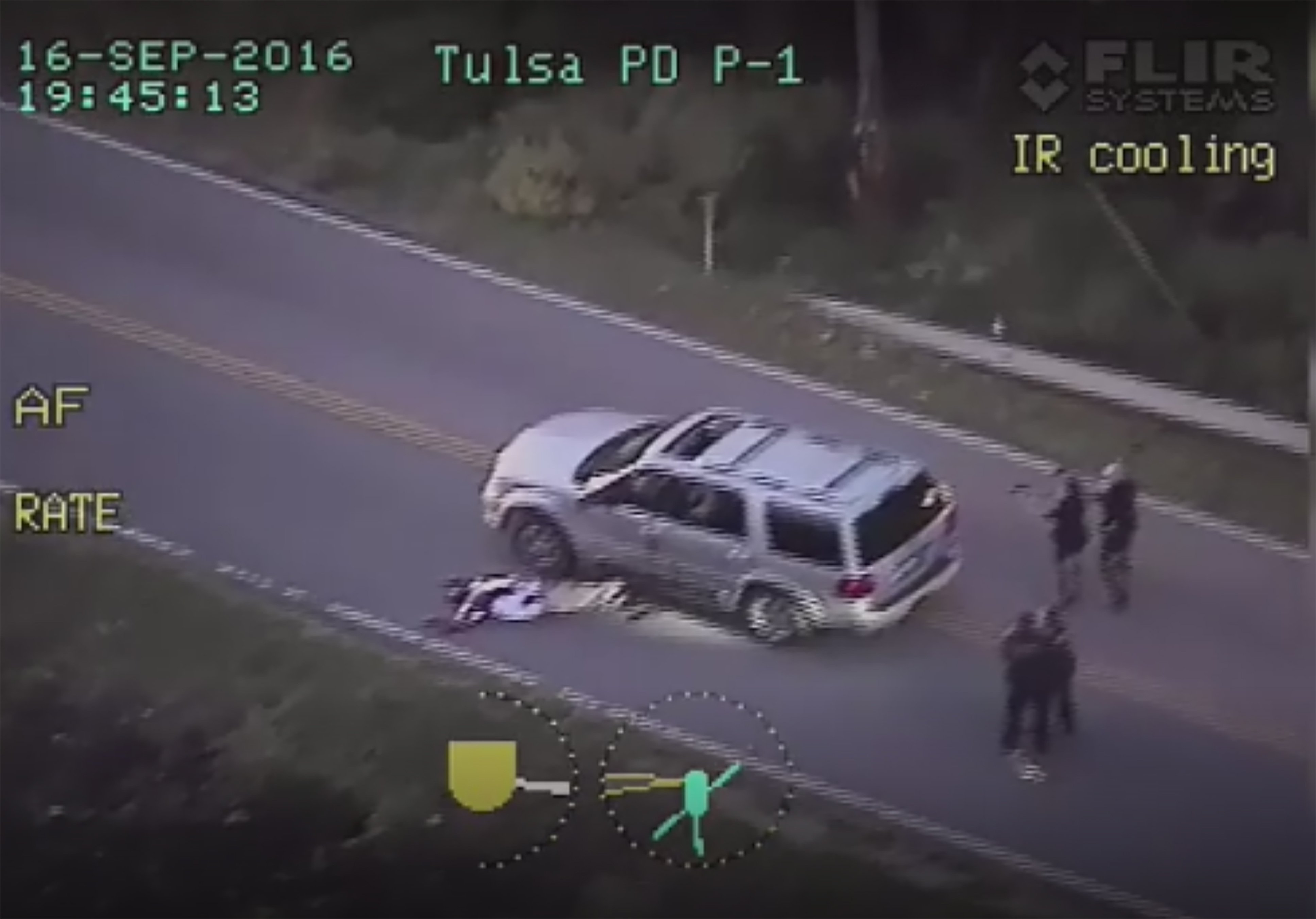 An image from a police helicopter video provided Sept. 20, 2016 by the Tulsa Police Department in Tulsa, Oklahoma, shows the officer involved shooting of Terence Crutcher.