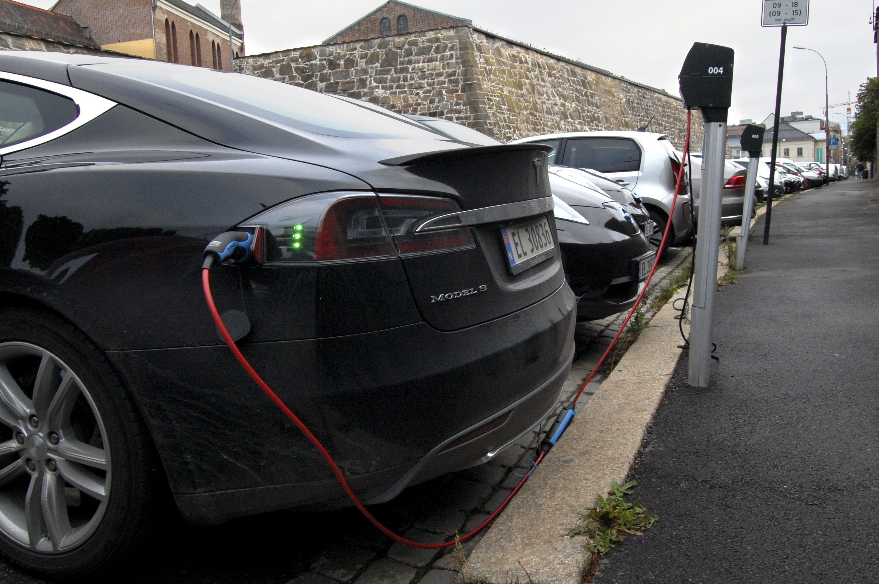 Cars are seen charging in free parking spaces for electric cars in central Oslo on Aug. 19, 2014.