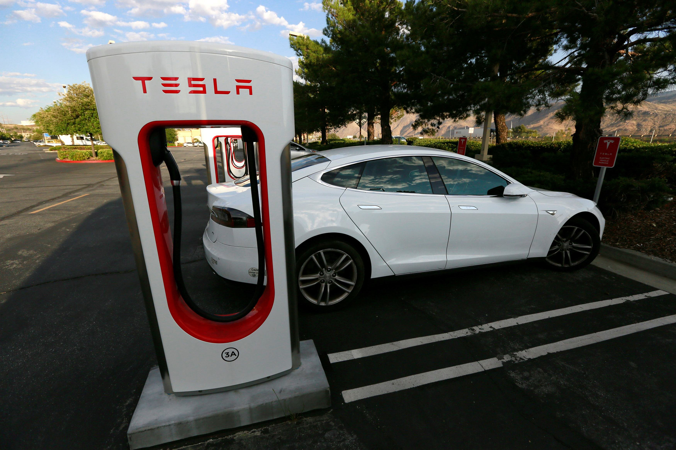 A Tesla Model S charges at a Tesla Supercharger station in Cabazon, Calif., May 18, 2016.