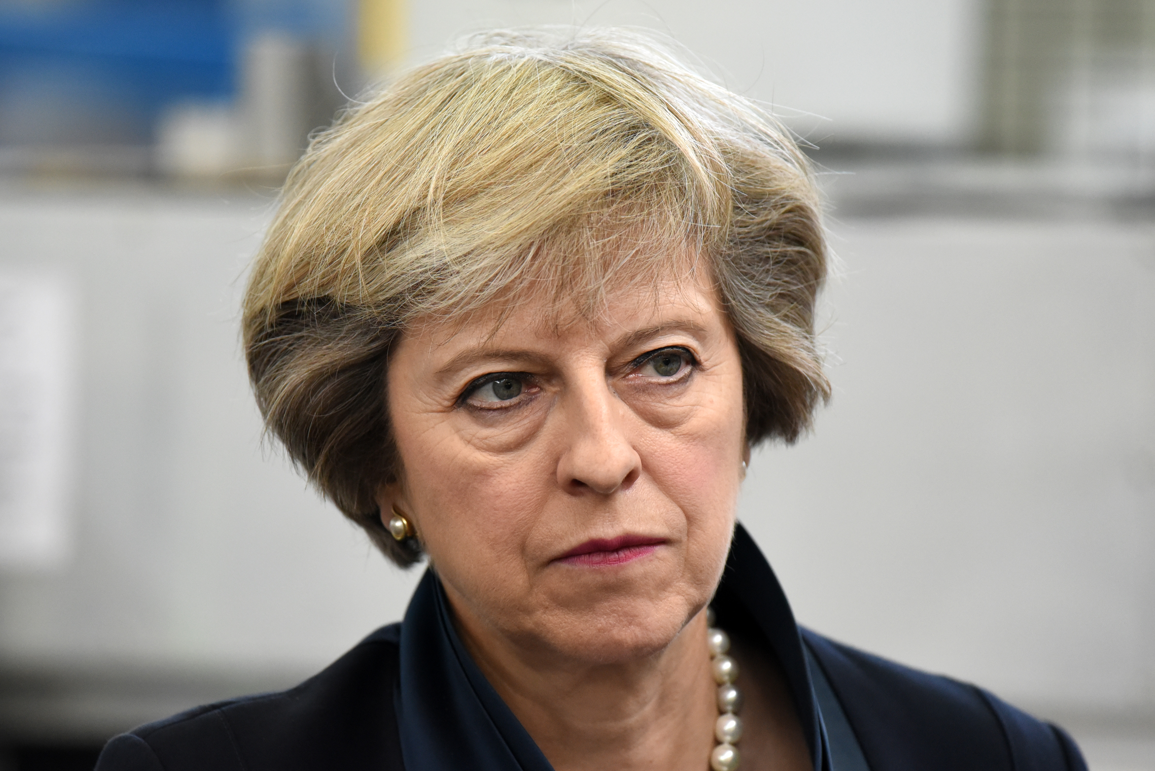 British Prime Minister Theresa May looks on during a visit to the Warwick Manufacturing Group facility at the University of Warwick on Sept. 1, 2016 in Solihull, England. Mrs May used the visit to highlight that Britain continues to be open for economic investment following the country's decision to leave the European Union.