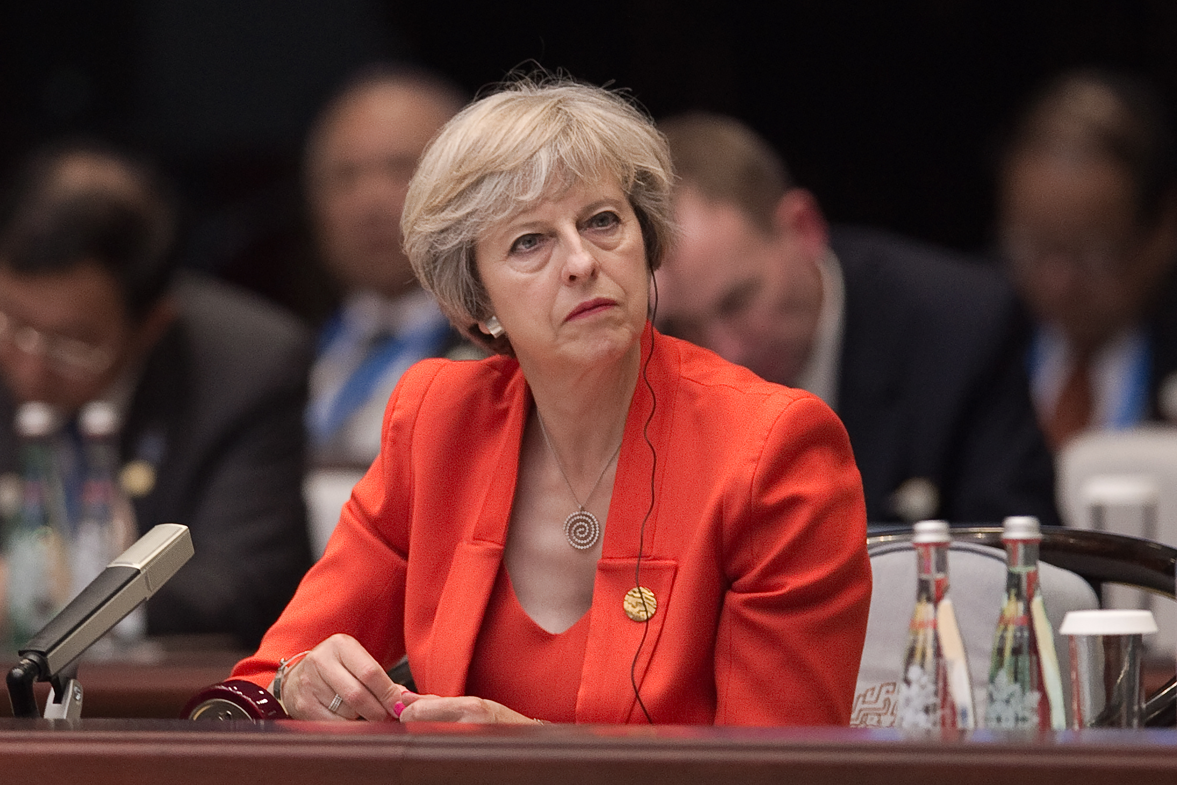 Britain's Prime Minister Theresa May listens to Chinese President Xi Jinping speech during the opening ceremony of the G20 Leaders Summit on September 4, 2016 in Hangzhou, China.