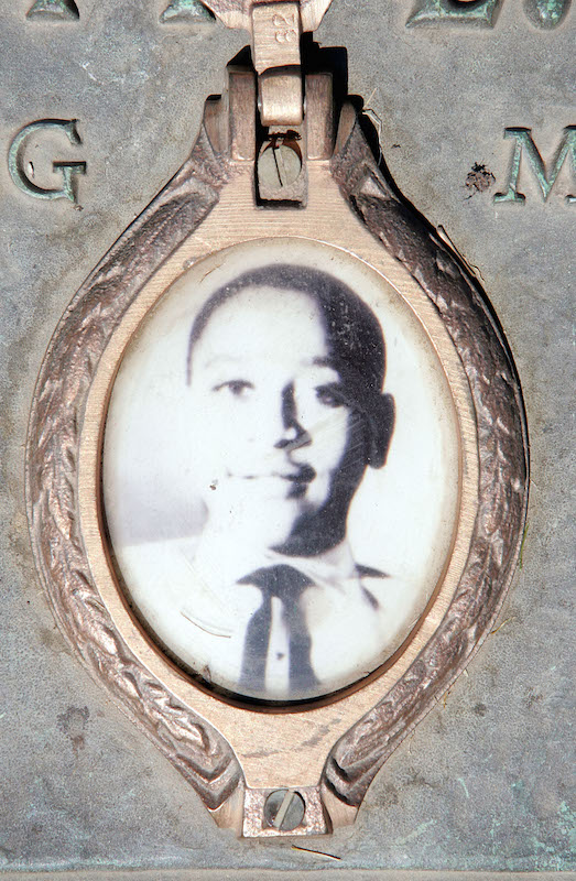 A photo of Emmett Till is included on the plaque that marks his gravesite at Burr Oak Cemetery in Aslip, Ill. Seen here in 2005.