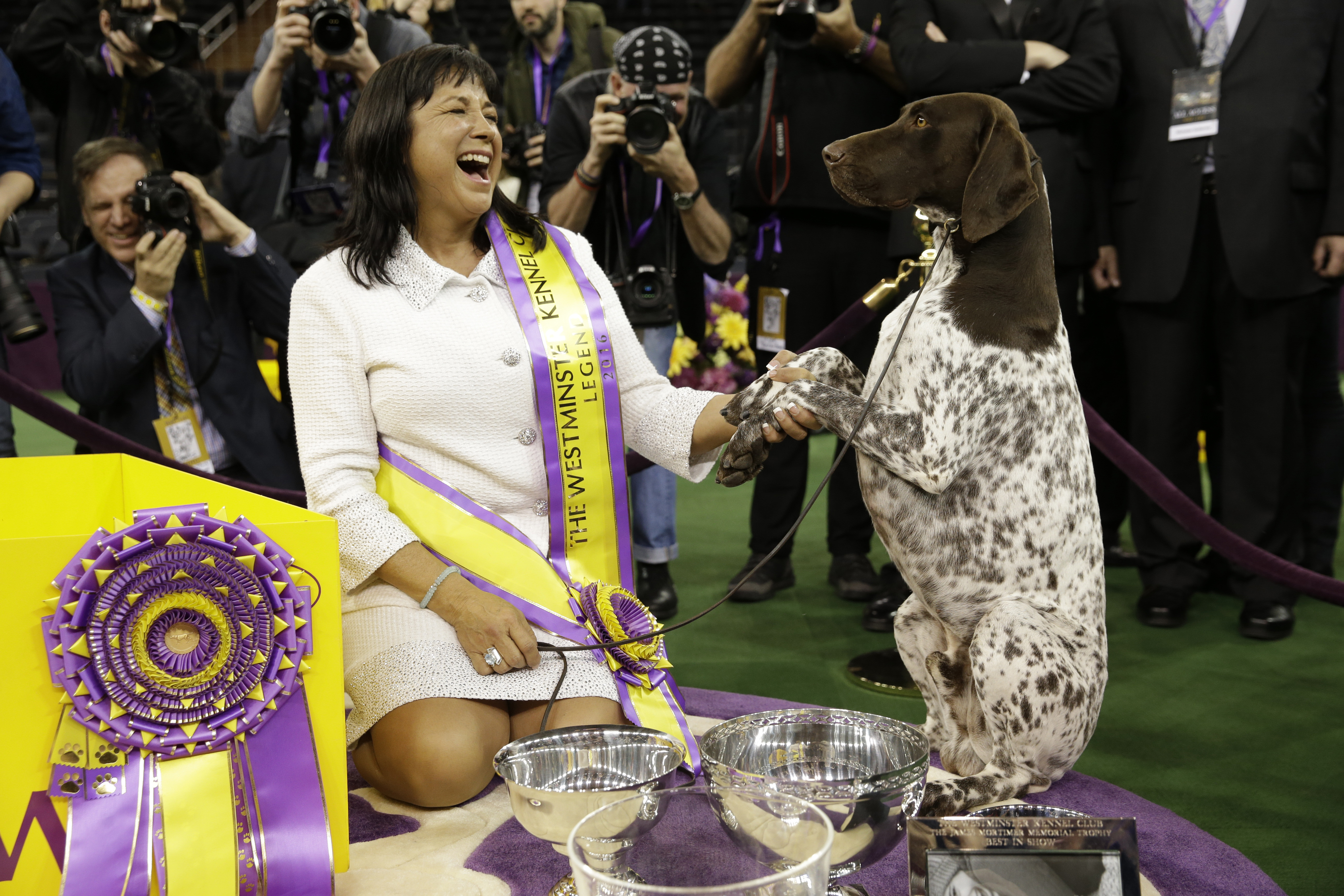 Valerie Nunes-Atkinson and CJ, a German shorthaired pointer, pose after CJ won best in show at the 140th Westminster Kennel Club dog show at Madison Square Garden in New York City, on Feb. 16, 2016.