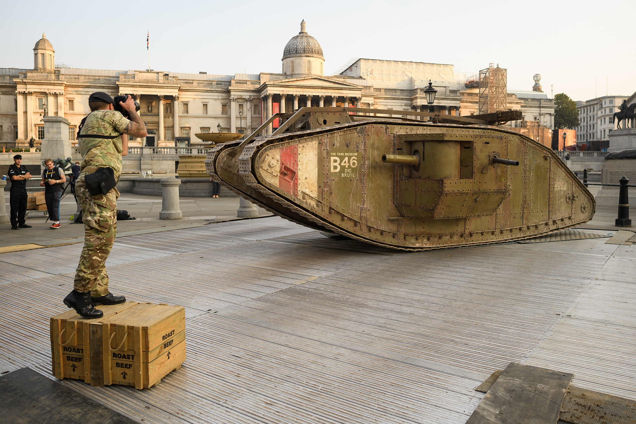 An Army photographer takes a photograph of a replica British Mark IV tank as it is displayed in Trafalgar Square in London on Sept. 15, 2016.