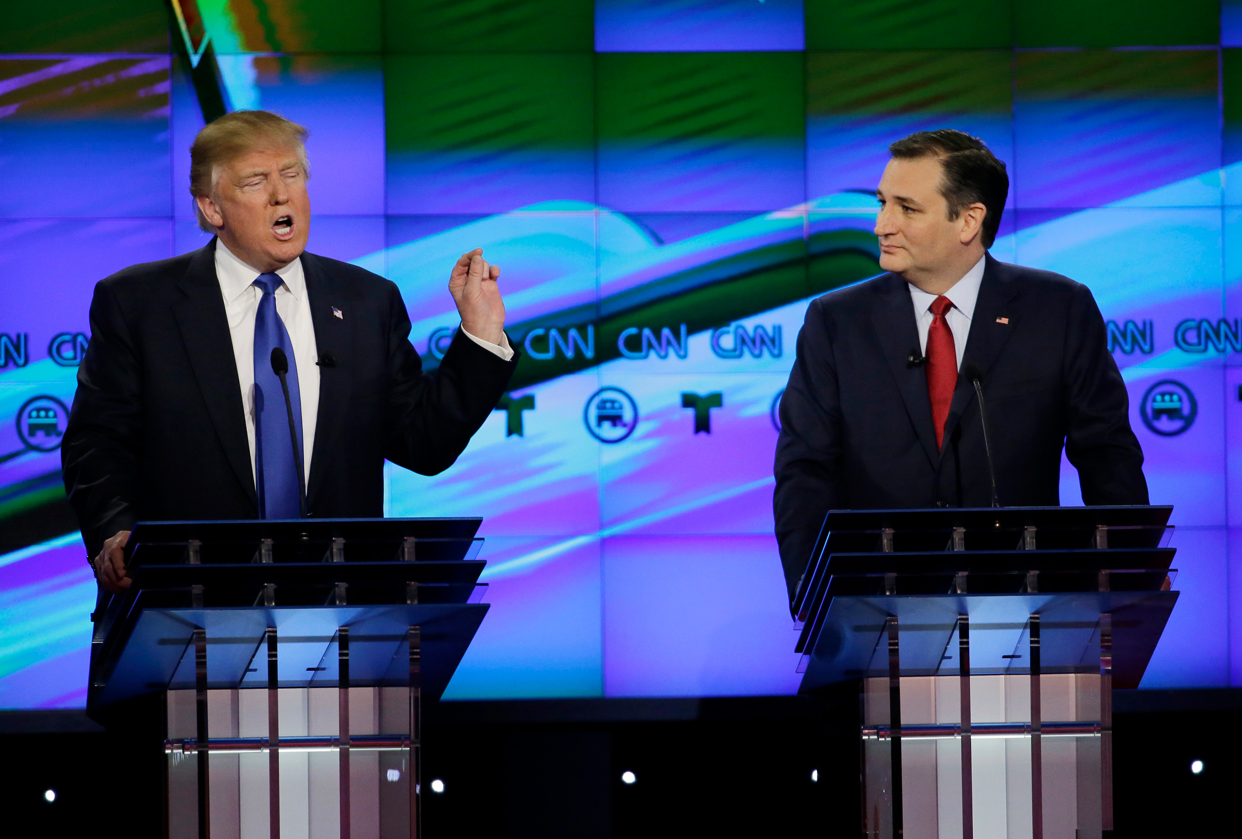 Sen. Ted Cruz, R-Texas listen as Donald Trump speaks during a Republican presidential primary debate at The University of Houston in Houston on Feb. 25, 2016.