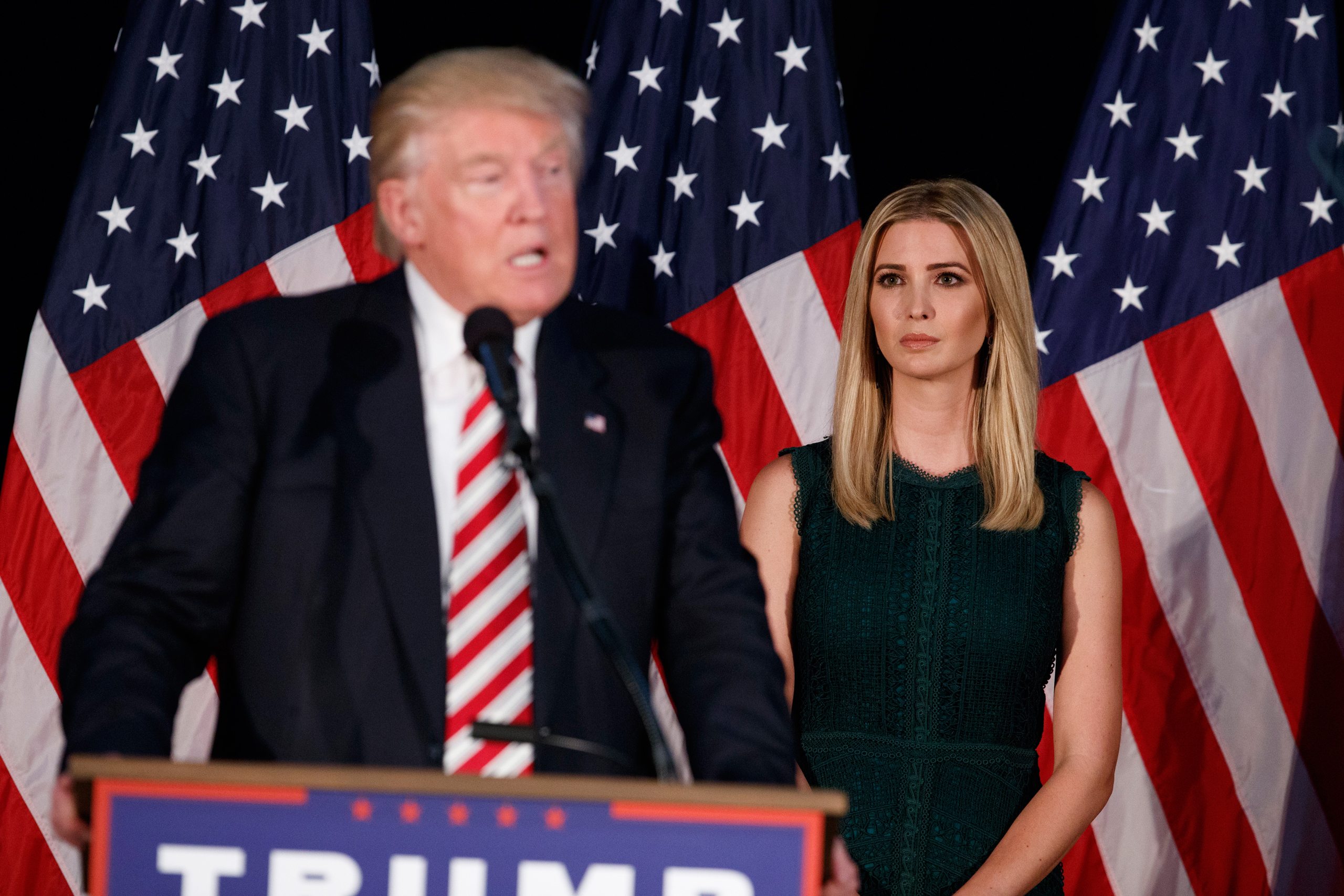 Ivanka Trump, right, looks on as her father, Republican presidential candidate Donald Trump, delivers a policy speech on child care in Aston, Penn., on Sept. 13, 2016.