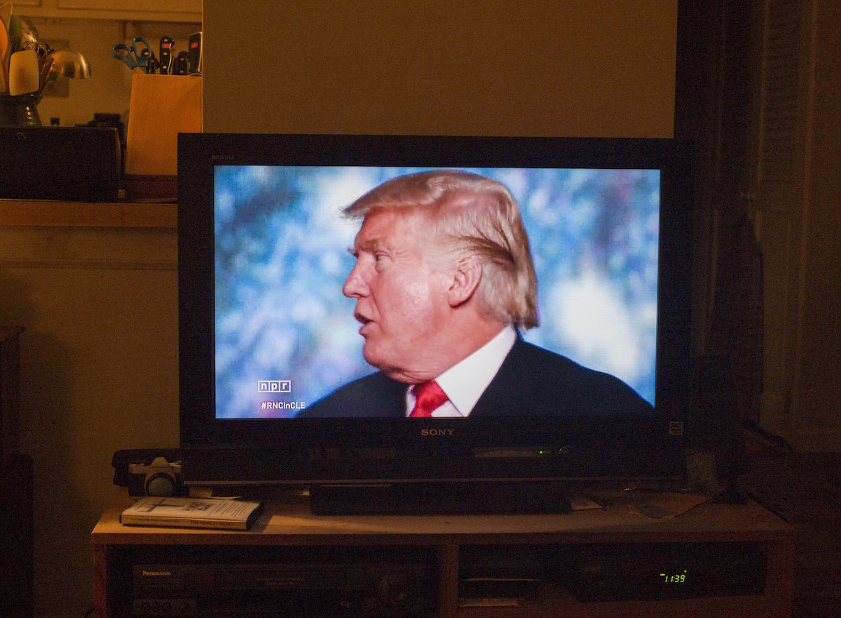Republican presidential candidate Donald Trump delivers a speech during the evening session on the fourth day of the Republican National Convention on July 21, 2016 at the Quicken Loans Arena in Cleveland, Ohio as shown on a television screen in Brooklyn, New York.