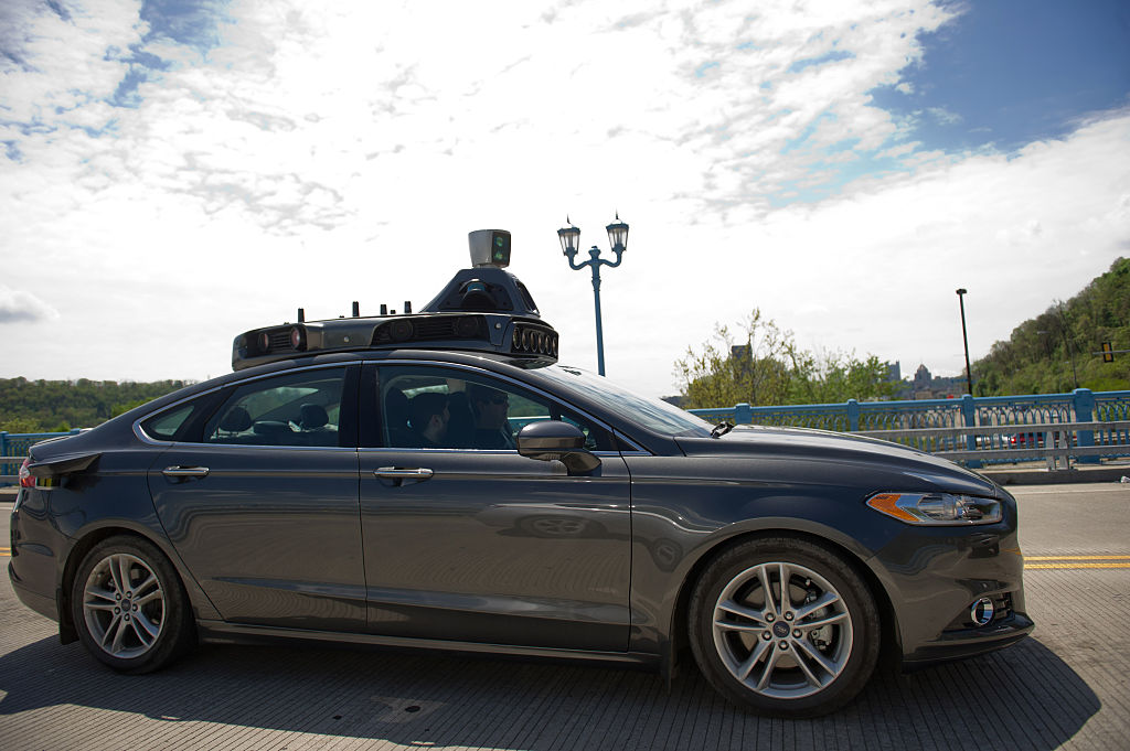 An Uber automated-vehicle taking a test-drive on the 31st Street Bridge.  The company has moved engineers and leased land throughout the Pittsburgh region in efforts to transform transportation for the world.