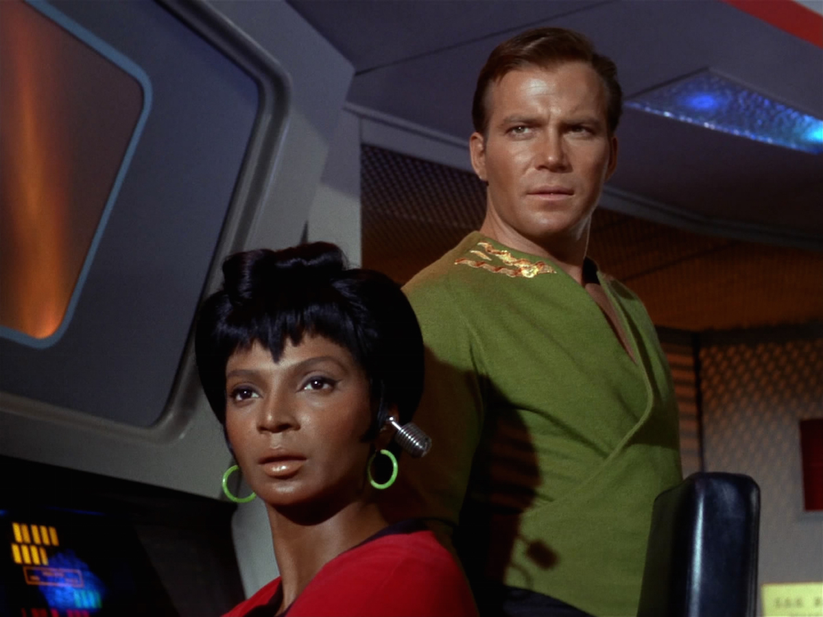 Nichelle Nichols as Lieutenant Uhura and William Shatner as Captain James T. Kirk in the STAR TREK episode,  Charlie X.   Season 1, episode, 2.  Original air date September 15, 1966.