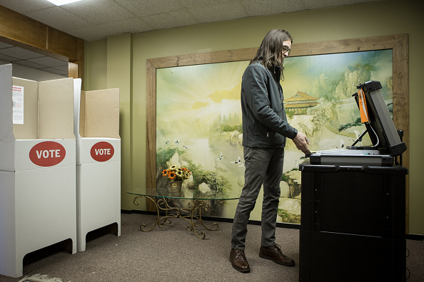 Scott Stuckey of Oklahoma City feeds a ballot into an optical scanner at Trinity Baptist Church on Super Tuesday March 1, 2016 in Oklahoma City.  Oklahoma voters head to the polls for the 2016 Presidential Primary.