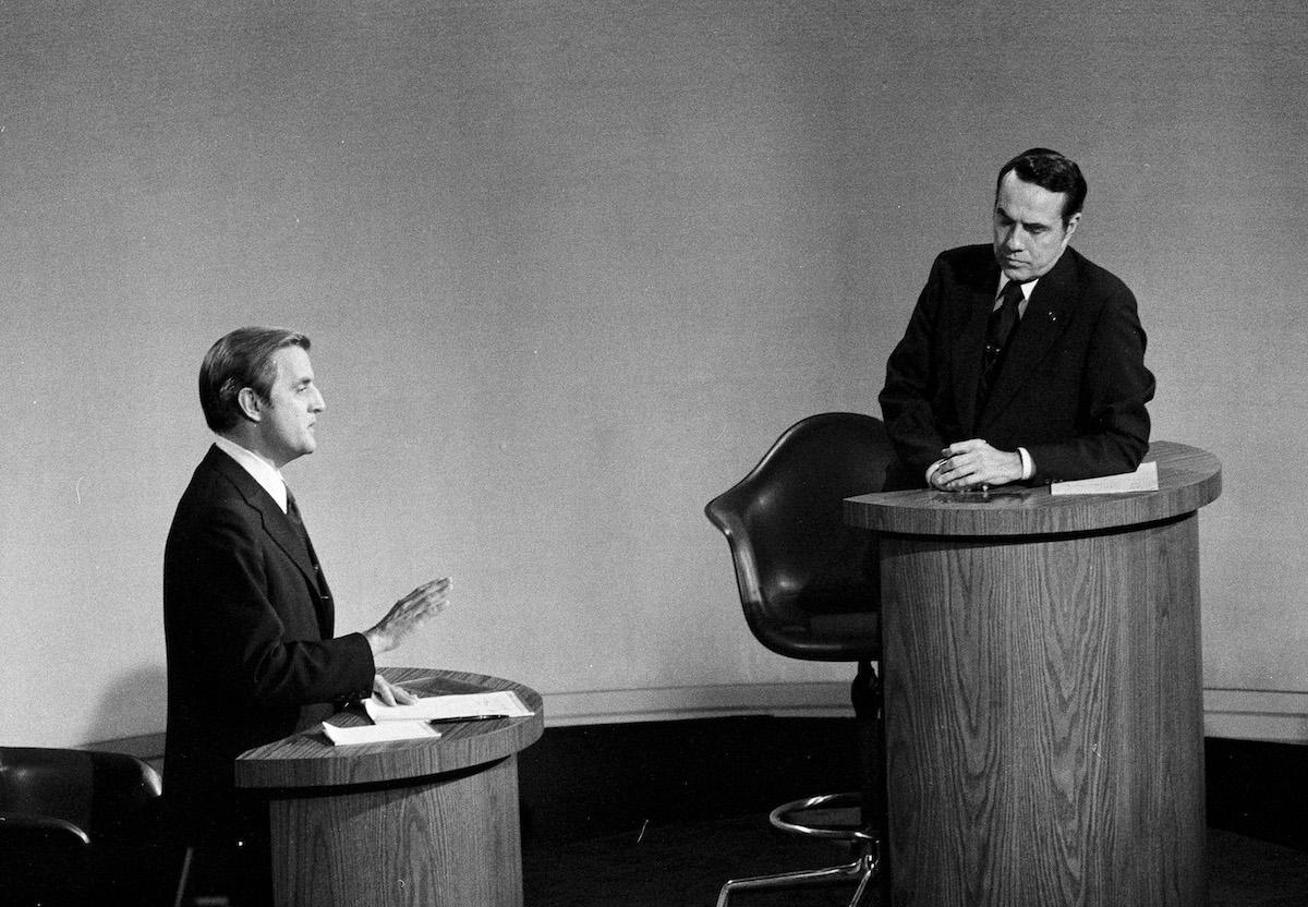 Senator Walter Mondale, D-Minn., left, speaks as Senator Robert Dole, R-Kan., listens during the Vice Presidential debate in Houston, Oct. 15, 1976.
