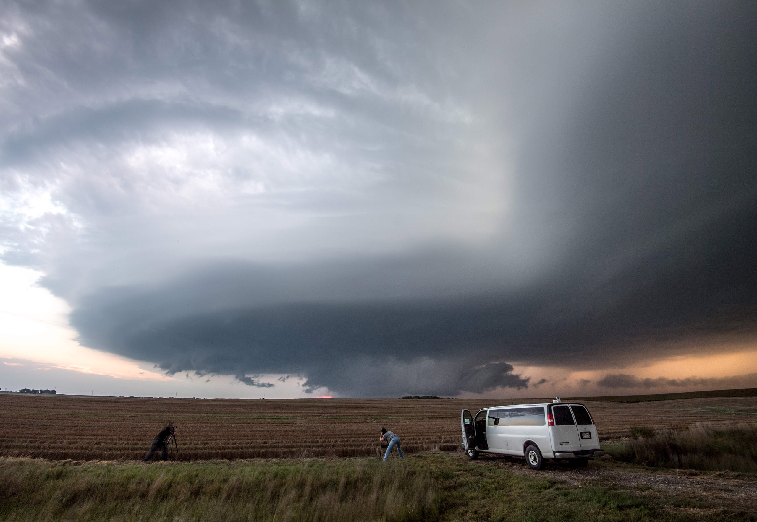 Storm chasing photographers underneath a rotating supercell storm system in Maxwell, Nebraska on Sept. 3, 2016.
