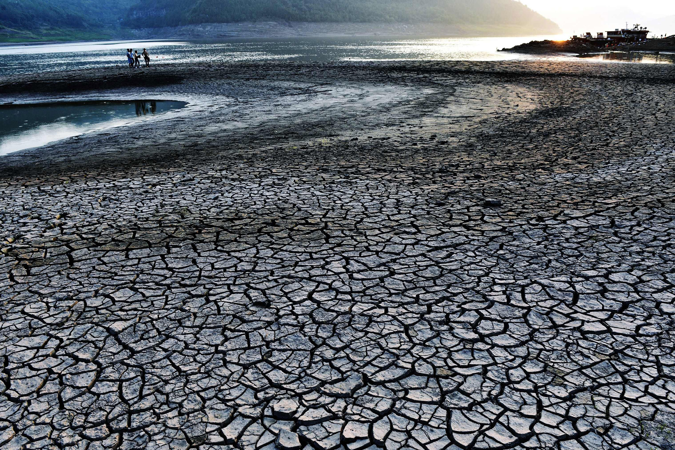 The dried and cracked river beach of the Yangtze River in Yunyang county in Chongqing, China. The Chongqing weather station issued a red alert for high temperatures for 12 consecutive days from Aug. 14 to Aug. 24, 2016.
